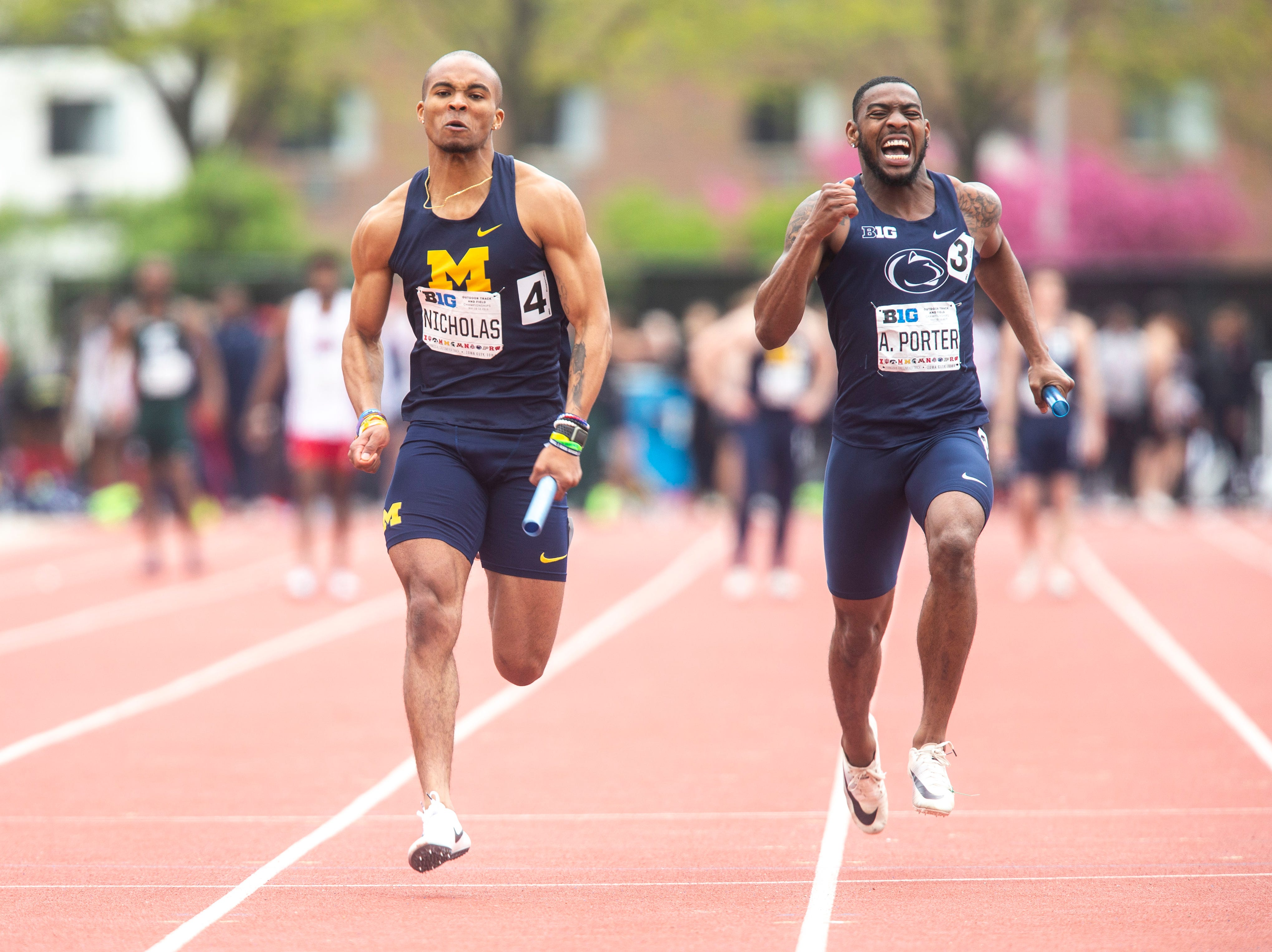Michigan's Desmond Nicholas (4) beats out Penn State's Anton Porter (3) at the finish line of the first heat of the 4x100 meter relay during the final day of Big Ten track and field outdoor championships, Sunday, May 12, 2019, at Francis X. Cretzmeyer Track on the University of Iowa campus in Iowa City, Iowa.