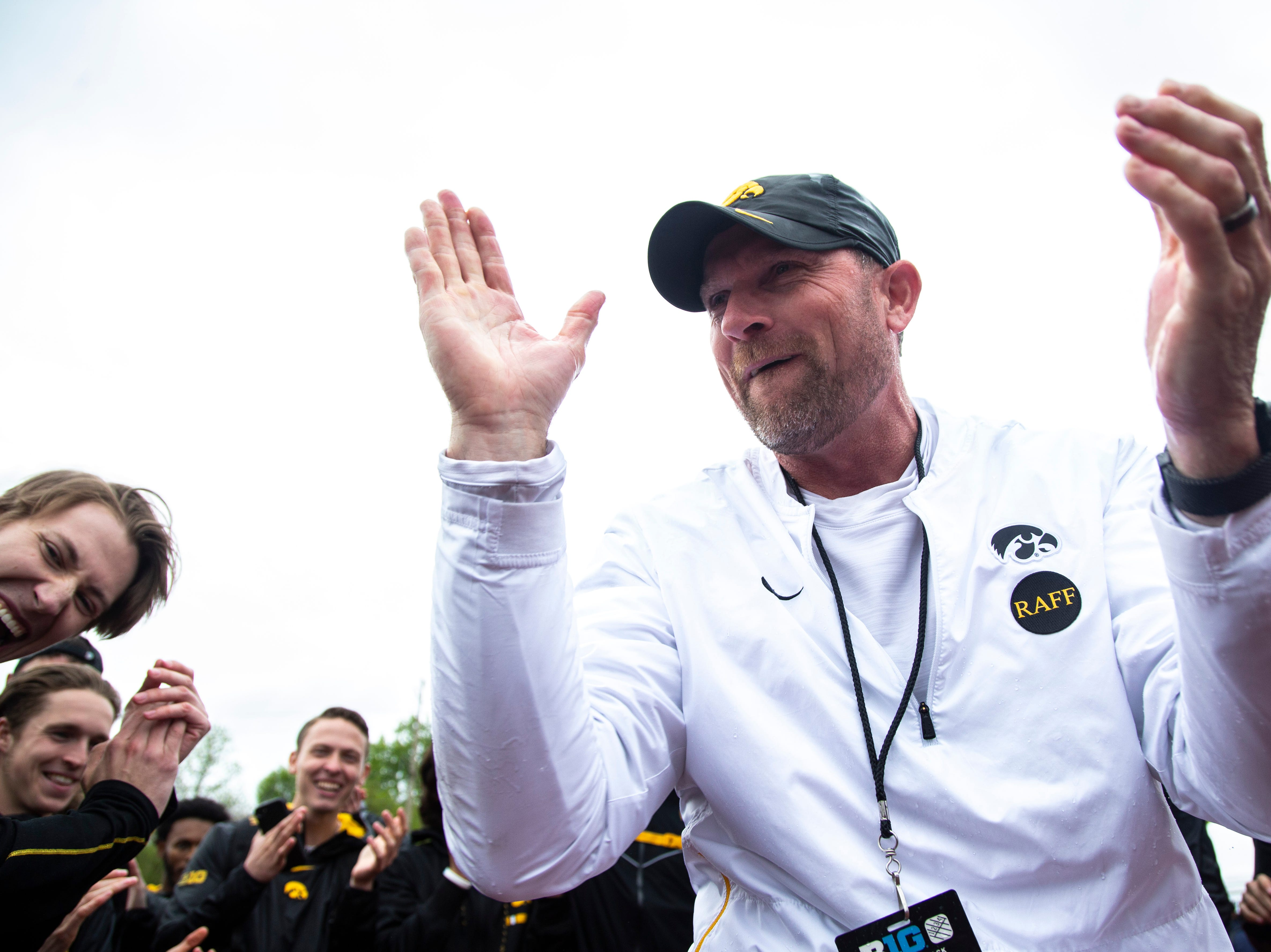 Joey Woody, the University of Iowa director of track and field, celebrates with players during the final day of Big Ten track and field outdoor championships, Sunday, May 12, 2019, at Francis X. Cretzmeyer Track on the University of Iowa campus in Iowa City, Iowa.
