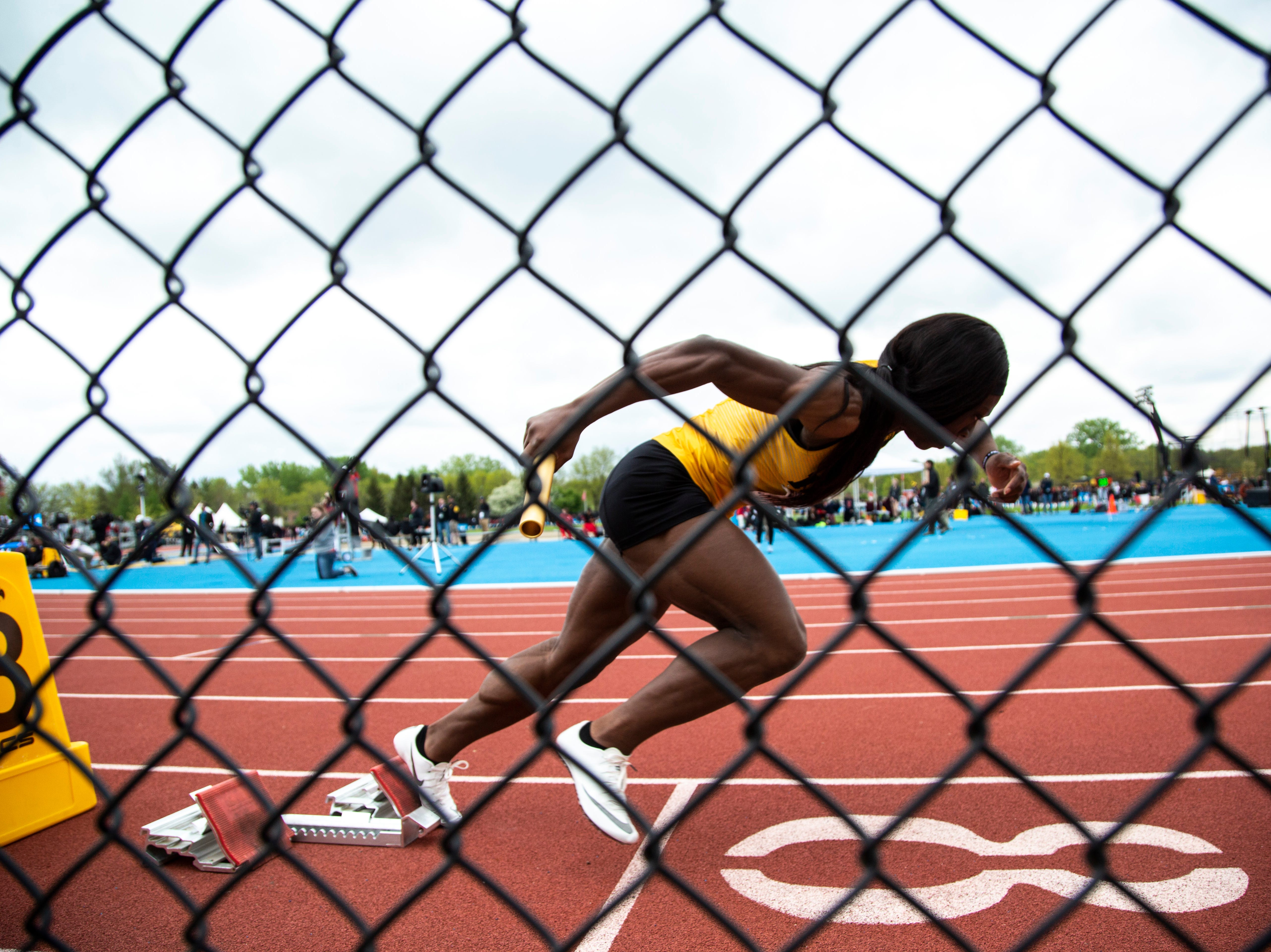 Iowa's Antonise Christian breaks out of the blocks during the 4x100 meter relay during the final day of Big Ten track and field outdoor championships, Sunday, May 12, 2019, at Francis X. Cretzmeyer Track on the University of Iowa campus in Iowa City, Iowa.