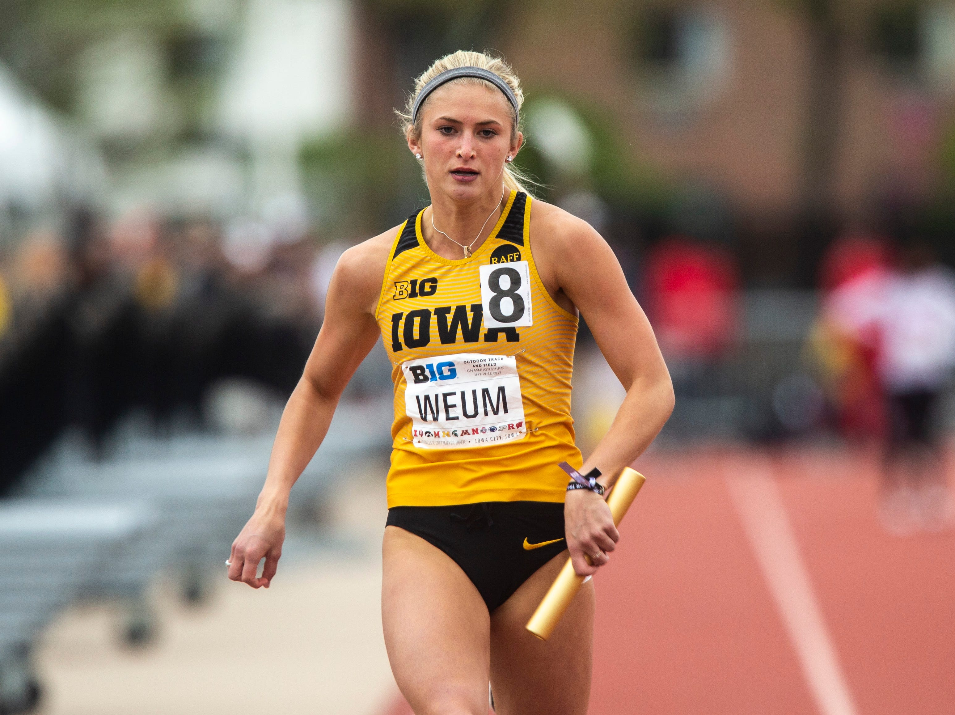 Iowa's Aly Weum anchors in the 4x100 meter relay during the final day of Big Ten track and field outdoor championships, Sunday, May 12, 2019, at Francis X. Cretzmeyer Track on the University of Iowa campus in Iowa City, Iowa.