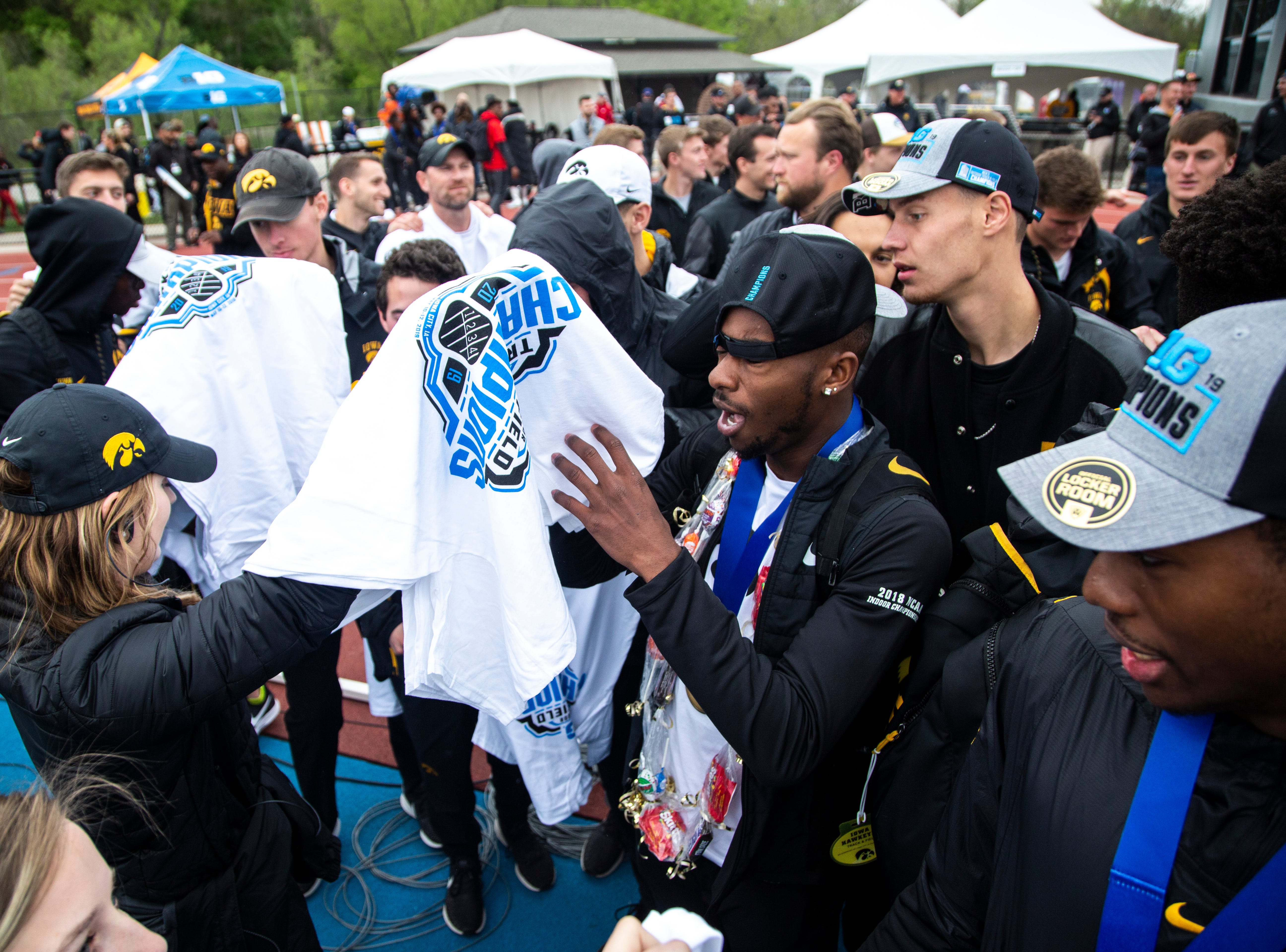 Iowa Hawkeyes men celebrate with Big Ten Championship t-shirts during the final day of Big Ten track and field outdoor championships, Sunday, May 12, 2019, at Francis X. Cretzmeyer Track on the University of Iowa campus in Iowa City, Iowa.