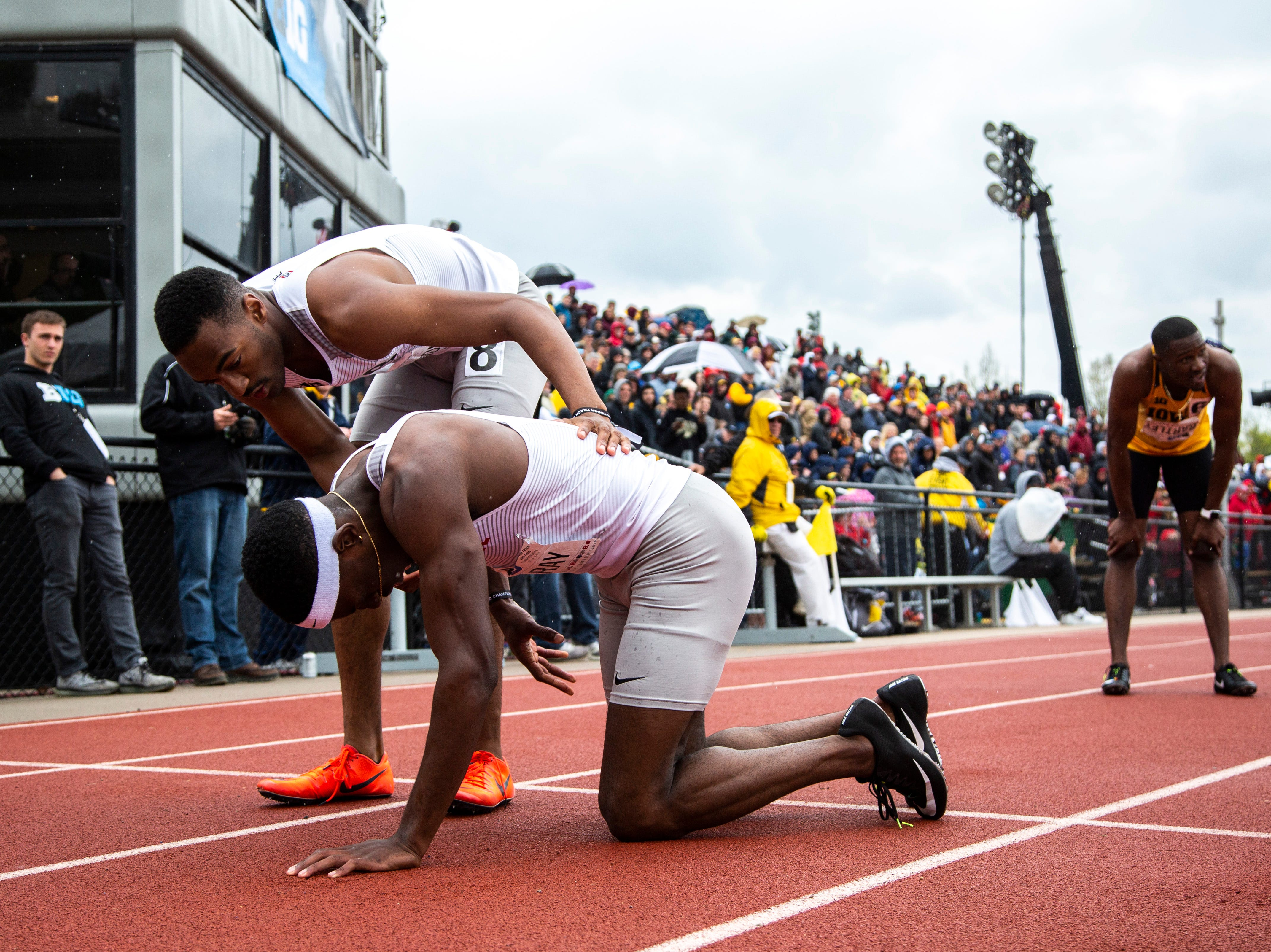 Ohio State senior Nick Gray gets comforted by teammate Tyler Johnson (8) after crossing the finish line in the 200 meter dash during the final day of Big Ten track and field outdoor championships, Sunday, May 12, 2019, at Francis X. Cretzmeyer Track on the University of Iowa campus in Iowa City, Iowa. Gray finished first, with a time of 20.23.