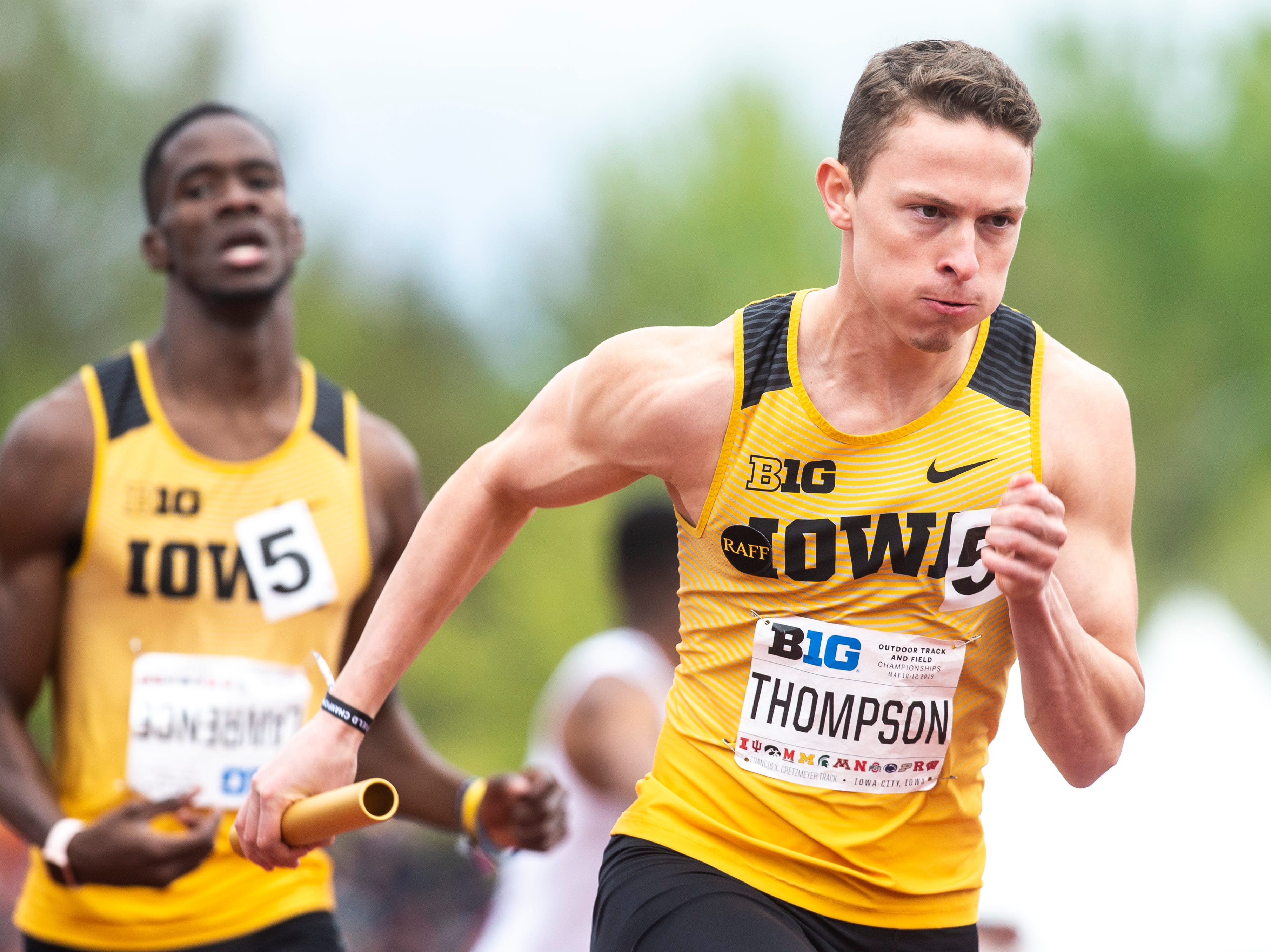 Iowa's Chris Thompson, right, takes a handoff from teammate Wayne Lawrence Jr. while they compete in the 4x400 meter relay during the final day of Big Ten track and field outdoor championships, Sunday, May 12, 2019, at Francis X. Cretzmeyer Track on the University of Iowa campus in Iowa City, Iowa. The Hawkeyes won, with a time of 3:07.36.