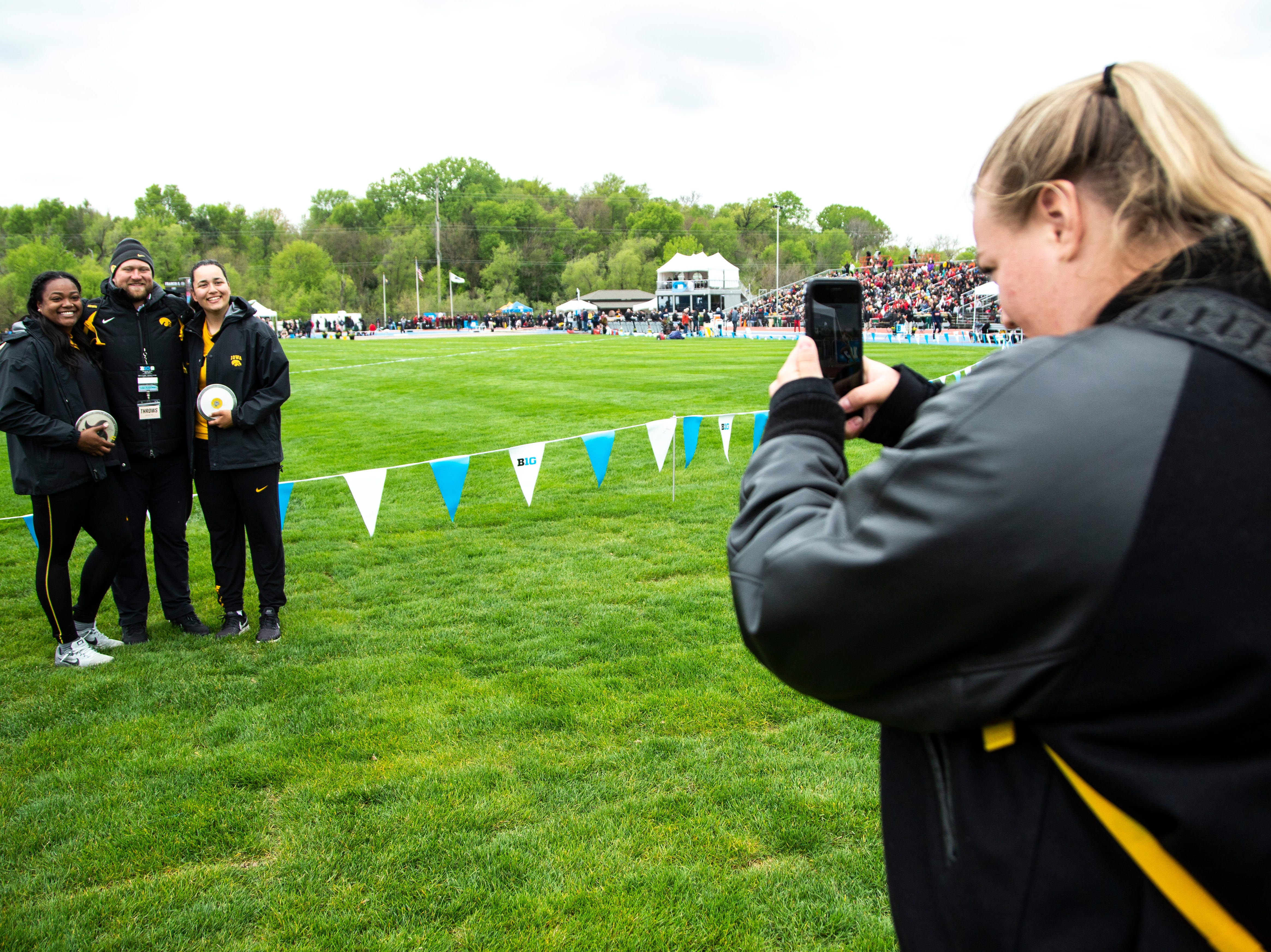 Iowa's Laulauga Tausaga, left, poses for a photo with coach Eric Werskey and teammate Konstadina Spanoudakis after taking first and second in discus during the final day of Big Ten track and field outdoor championships, Sunday, May 12, 2019, at Francis X. Cretzmeyer Track on the University of Iowa campus in Iowa City, Iowa.