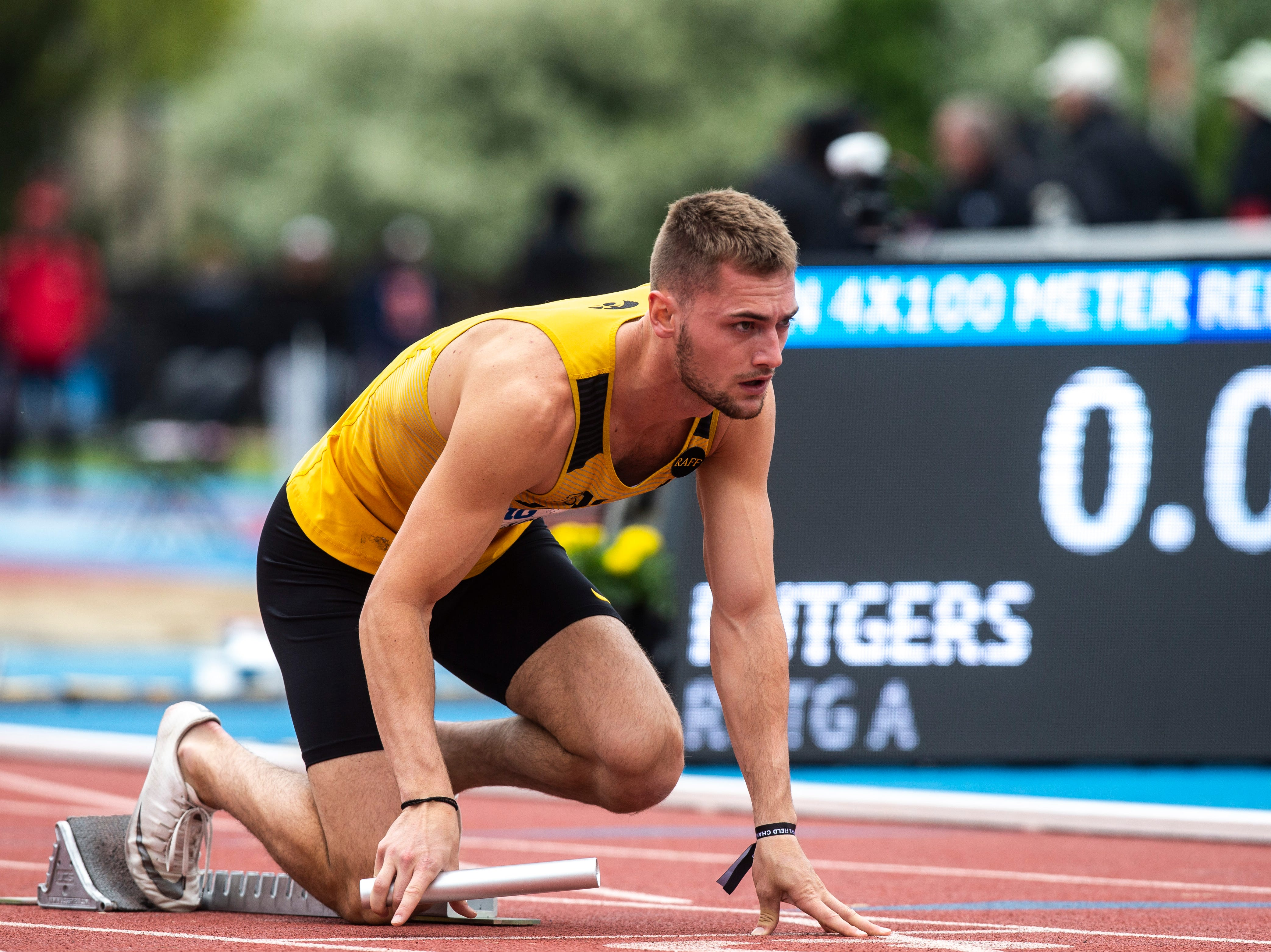 Iowa's Collin Hofacker gets ready on the blocks before the 4x100 meter relay during the final day of Big Ten track and field outdoor championships, Sunday, May 12, 2019, at Francis X. Cretzmeyer Track on the University of Iowa campus in Iowa City, Iowa.