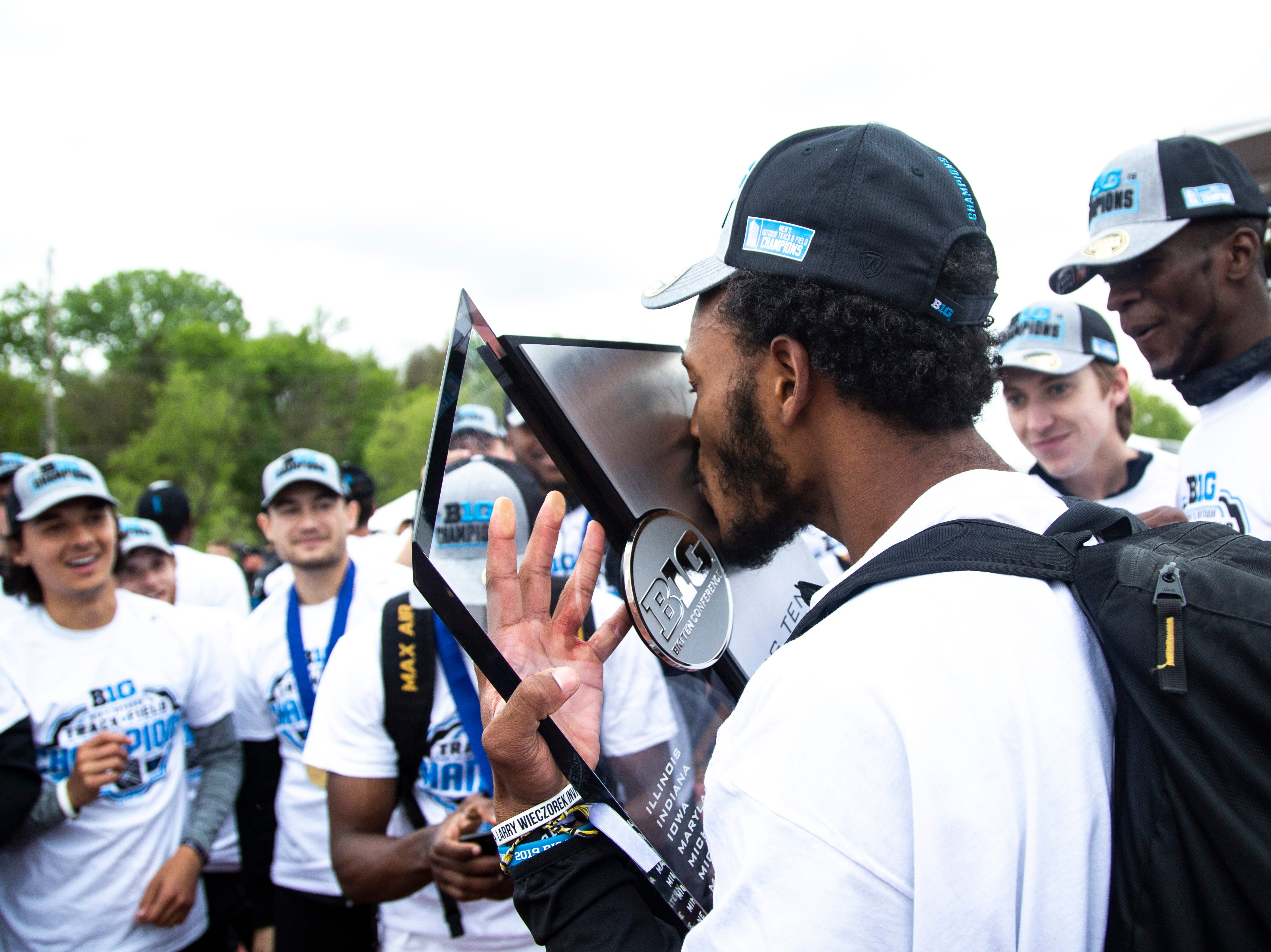 Iowa's Mar'yea Harris kisses the Big Ten Championship trophy during the final day of Big Ten track and field outdoor championships, Sunday, May 12, 2019, at Francis X. Cretzmeyer Track on the University of Iowa campus in Iowa City, Iowa.