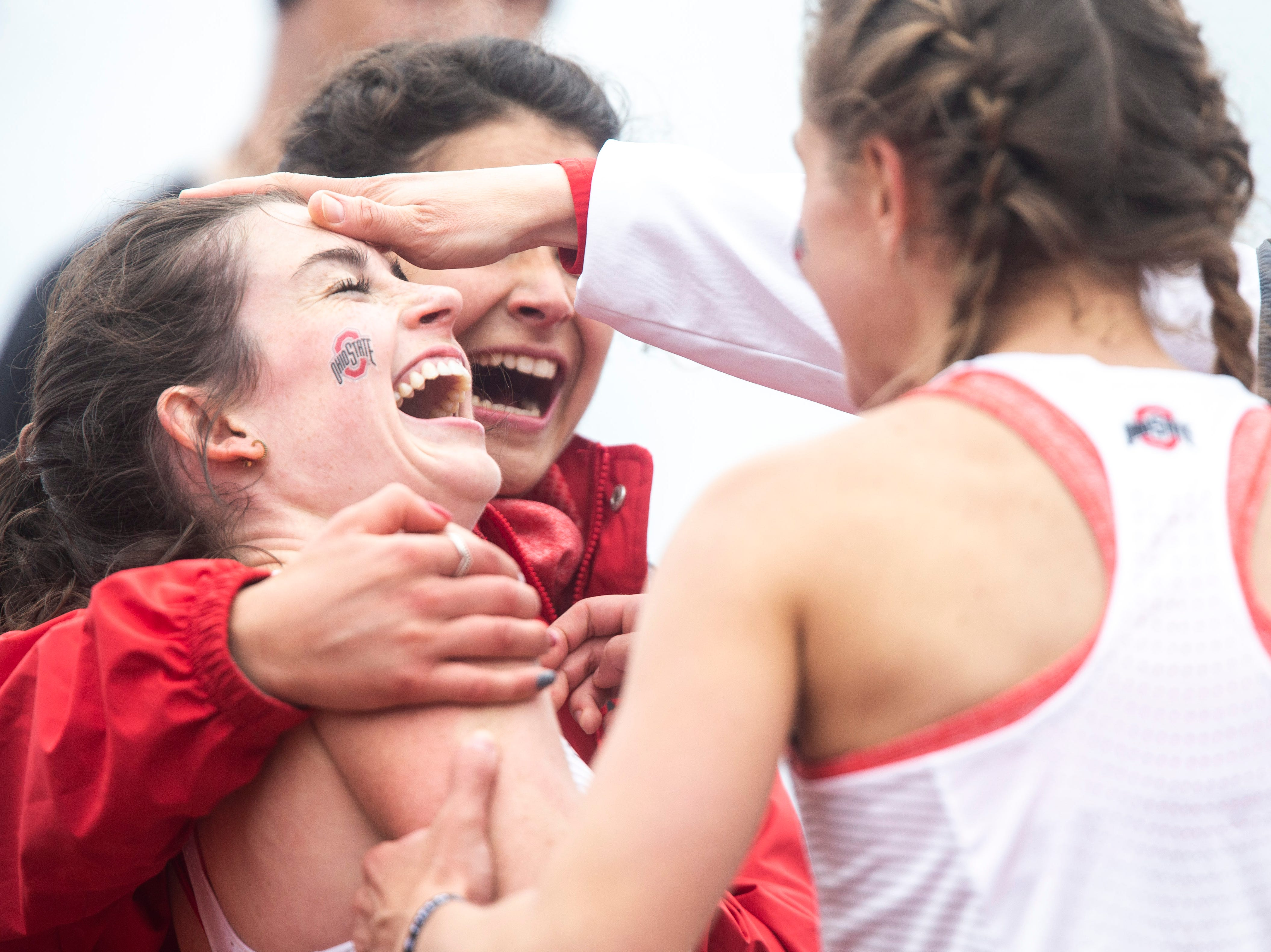 Ohio State sophomore Abby Nichols gets embraced by teammates after crossing the finish line in the 5,000 meter finals during the final day of Big Ten track and field outdoor championships, Sunday, May 12, 2019, at Francis X. Cretzmeyer Track on the University of Iowa campus in Iowa City, Iowa. Nichols finished first, with a time of 15:56.52, setting a school record.