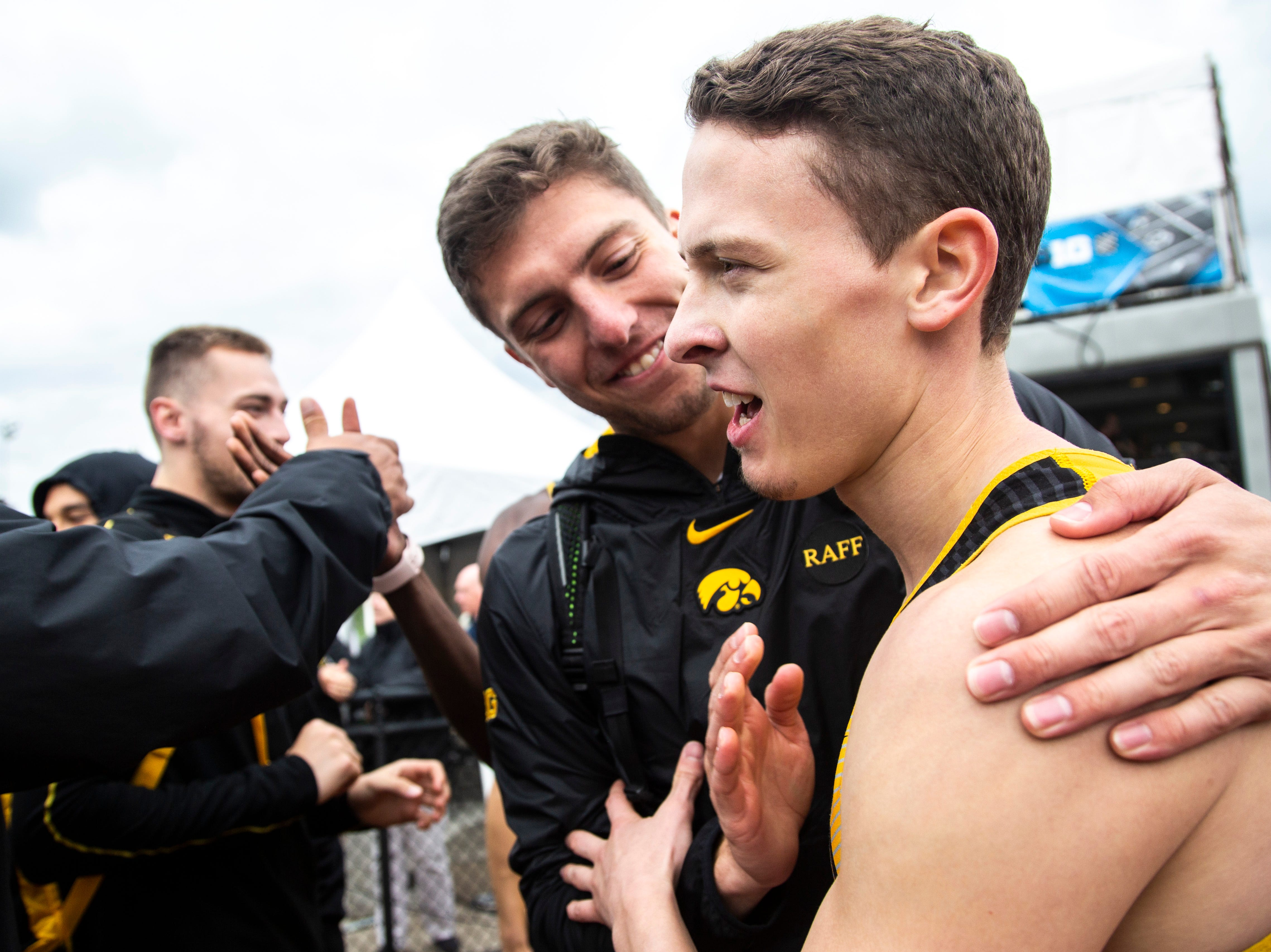 Iowa's Chris Thompson gets embraced by teammates during the final day of Big Ten track and field outdoor championships, Sunday, May 12, 2019, at Francis X. Cretzmeyer Track on the University of Iowa campus in Iowa City, Iowa.