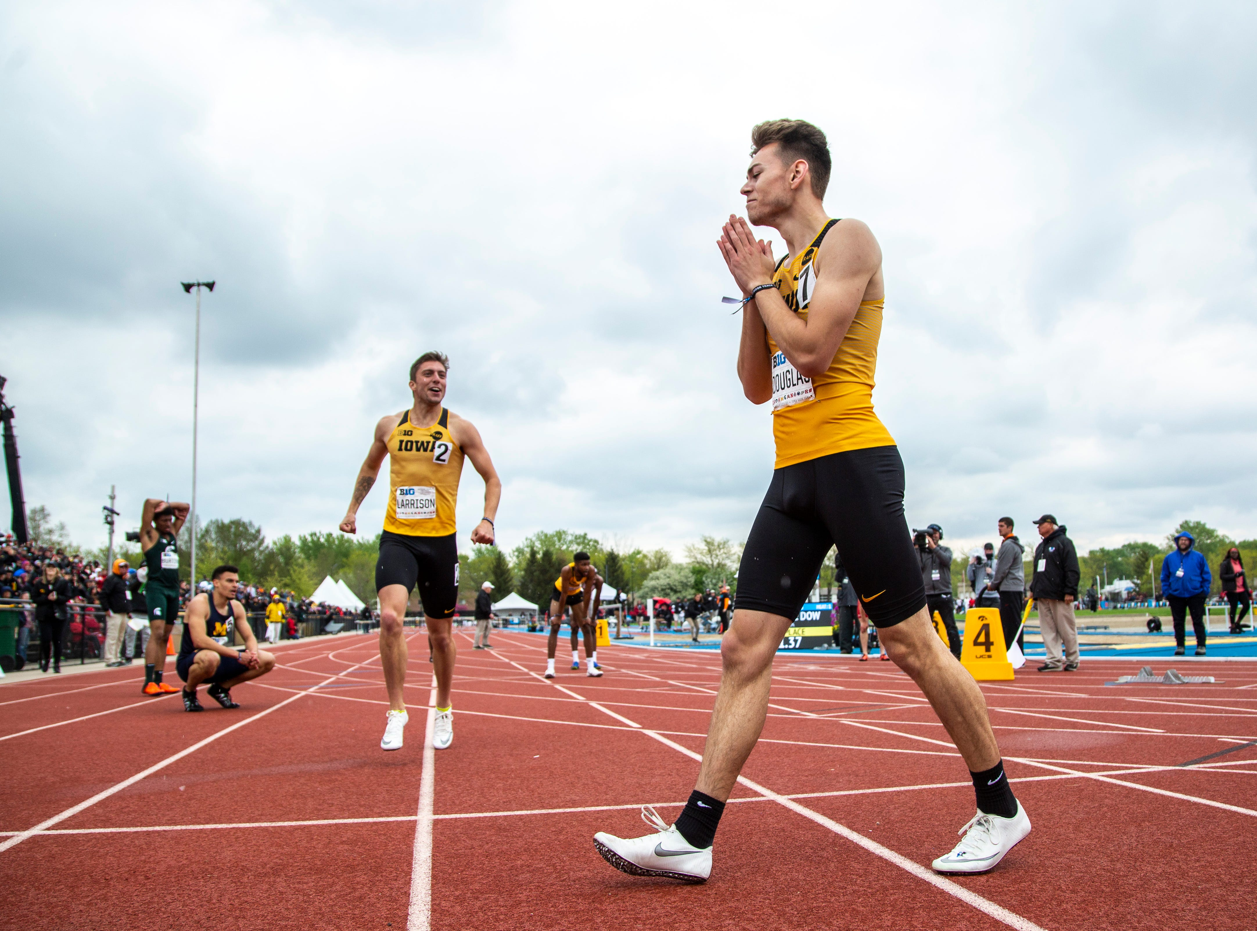 Iowa senior Chris Douglas celebrates after crossing the finish line in the 400 meter hurdles during the final day of Big Ten track and field outdoor championships, Sunday, May 12, 2019, at Francis X. Cretzmeyer Track on the University of Iowa campus in Iowa City, Iowa. Douglas finished first, with a time of 50.32, a career best.