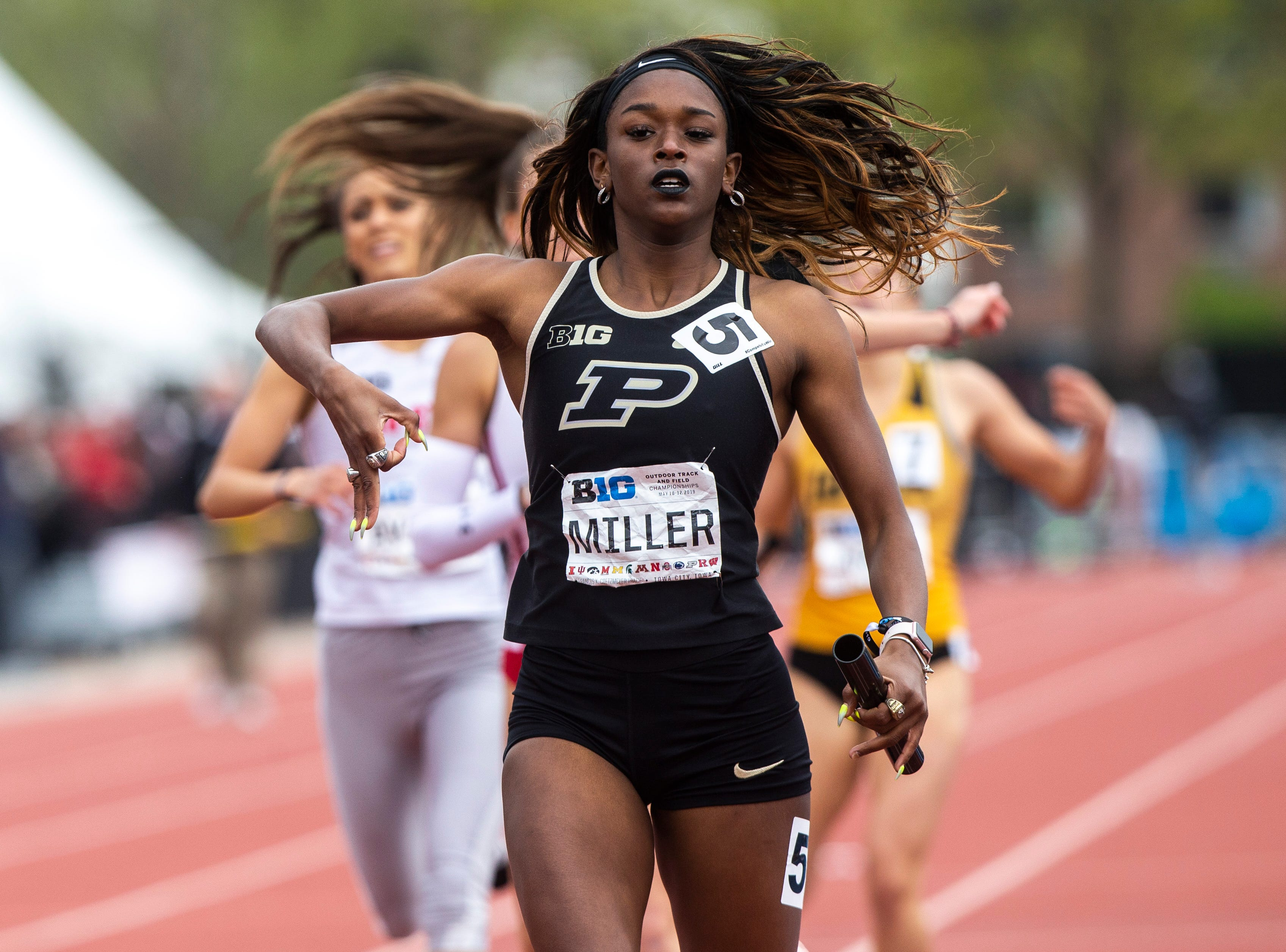 Purdue's Samara Miller celebrates while crossing the finish line in the 4x400 meter relay during the final day of Big Ten track and field outdoor championships, Sunday, May 12, 2019, at Francis X. Cretzmeyer Track on the University of Iowa campus in Iowa City, Iowa. Purdue finished first, with a time of 3:36.63