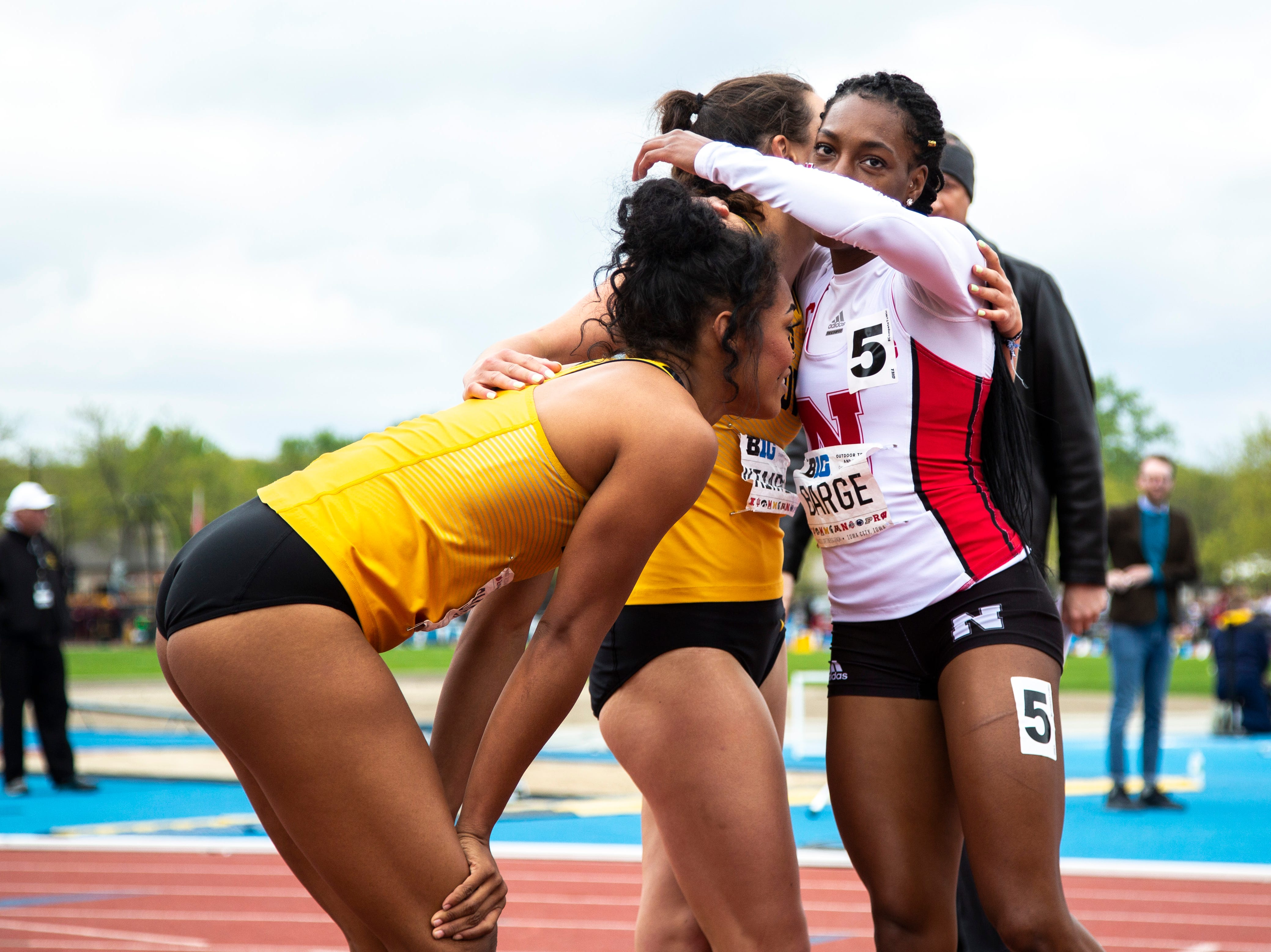 Nebraska's Jasmine Barge (5) hugs Iowa's Jenny Kimbo after competing in the 100 meter hurdles during the final day of Big Ten track and field outdoor championships, Sunday, May 12, 2019, at Francis X. Cretzmeyer Track on the University of Iowa campus in Iowa City, Iowa. Barge took first, with a time of 13.25, Kimbo finished second, with a time of 13.38.