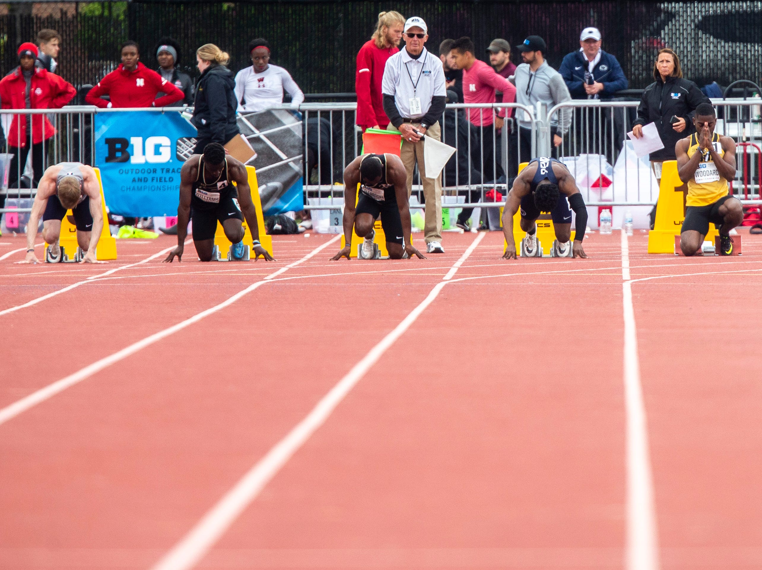 Iowa's Antonio Woodard, far right, prays before the 100 meter dash finals during the final day of Big Ten track and field outdoor championships, Sunday, May 12, 2019, at Francis X. Cretzmeyer Track on the University of Iowa campus in Iowa City, Iowa. Woodard finished seventh, with a time of 10.40.