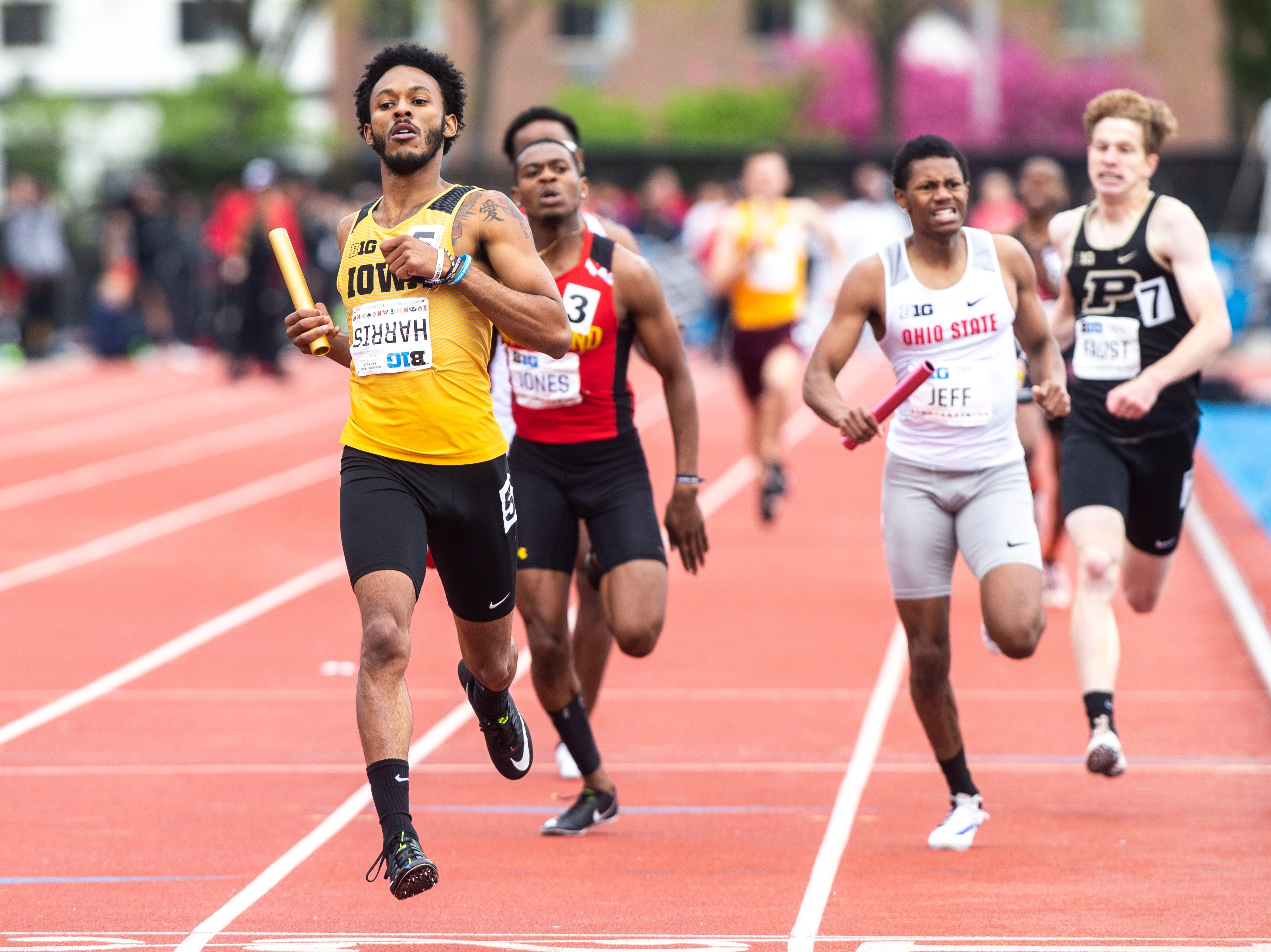 Iowa's Mar'yea Harris crosses the finish line in the 4x400 meter relay during the final day of Big Ten track and field outdoor championships, Sunday, May 12, 2019, at Francis X. Cretzmeyer Track on the University of Iowa campus in Iowa City, Iowa. The Hawkeyes won, with a time of 3:07.36.