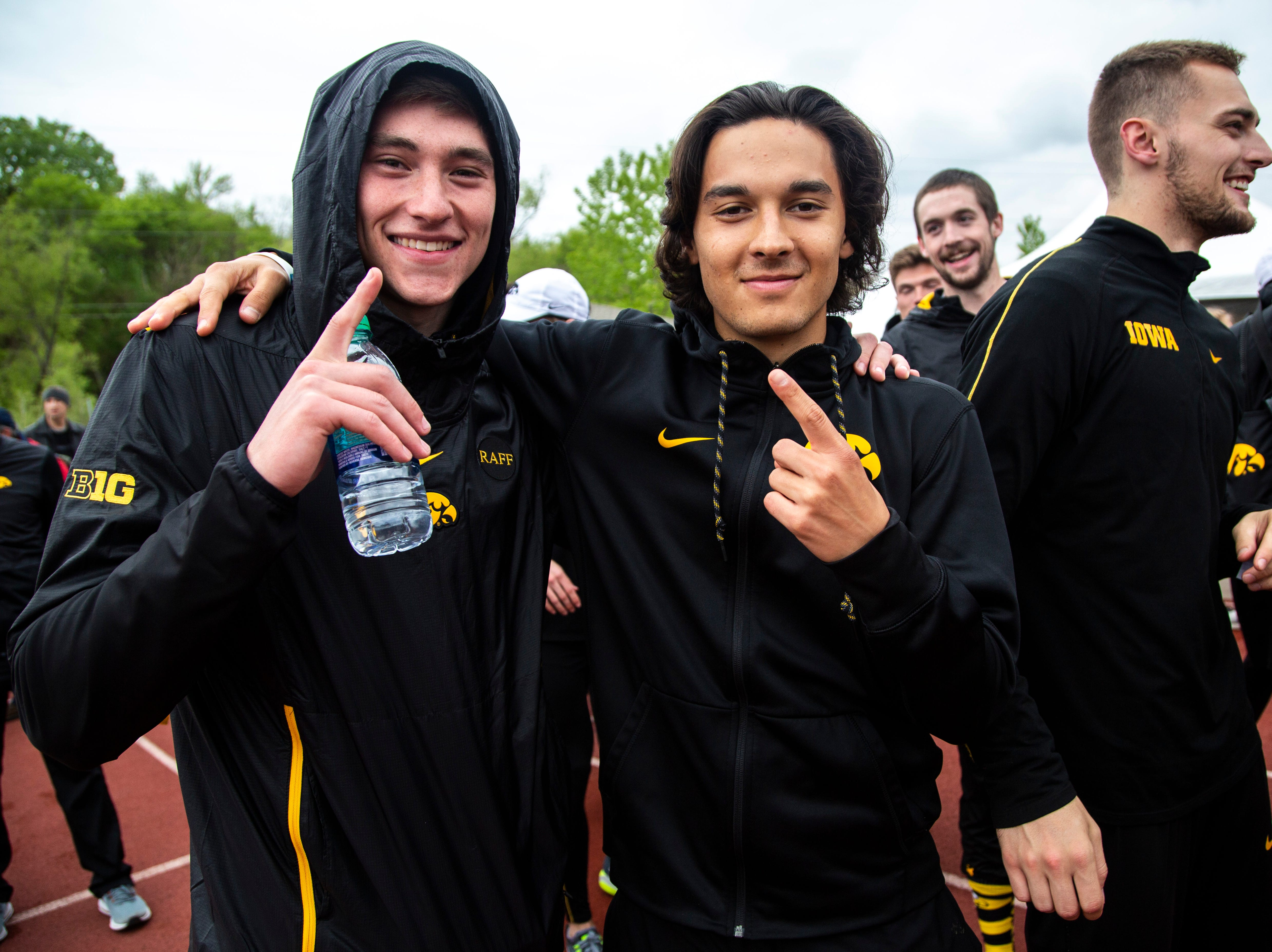 Iowa Hawkeyes men celebrate after the final day of Big Ten track and field outdoor championships, Sunday, May 12, 2019, at Francis X. Cretzmeyer Track on the University of Iowa campus in Iowa City, Iowa.