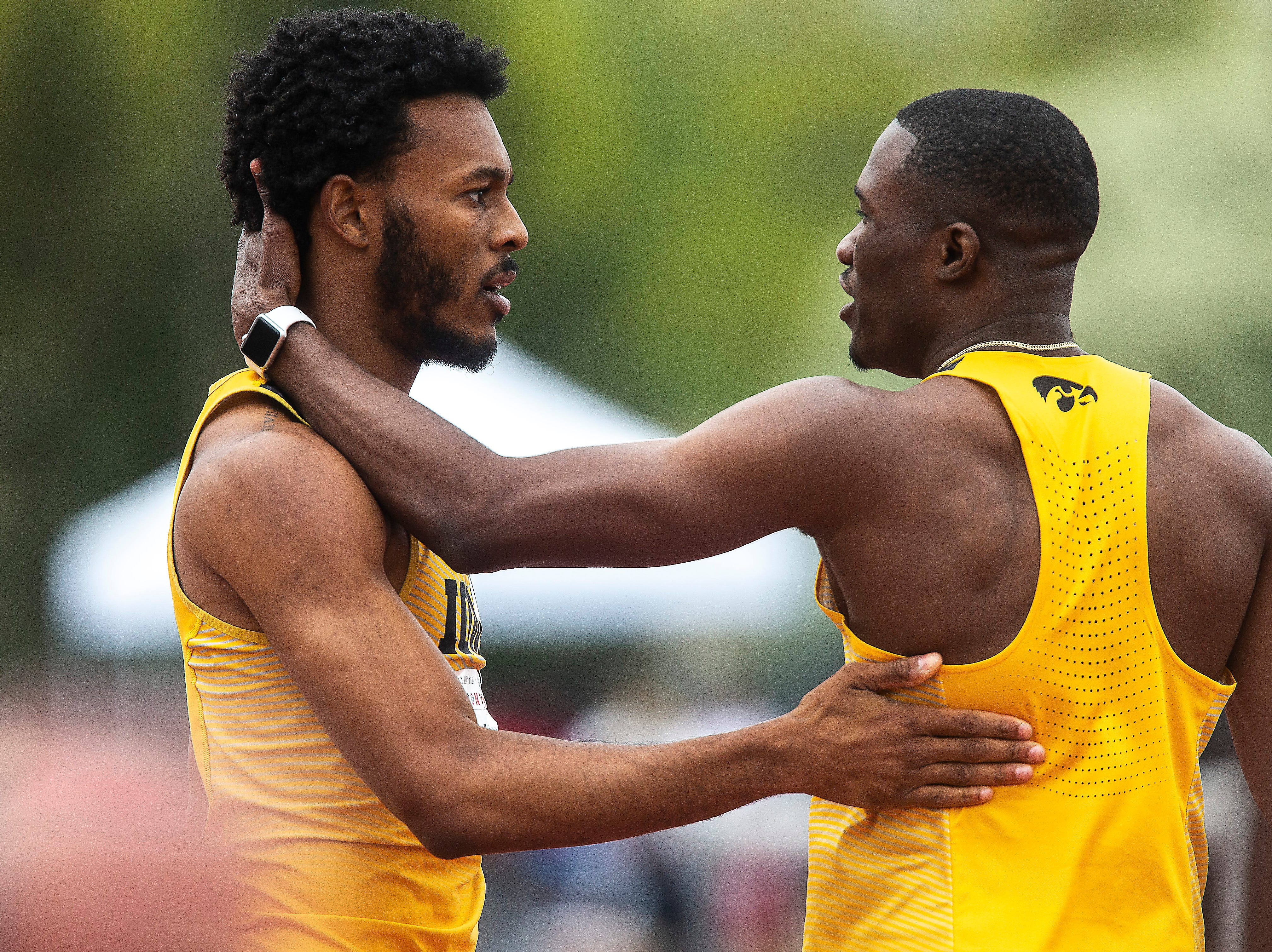 Iowa junior Karayme Bartley, right, embraces teammate Mar'yea Harris after competing in the 400 meter finals during the final day of Big Ten track and field outdoor championships, Sunday, May 12, 2019, at Francis X. Cretzmeyer Track on the University of Iowa campus in Iowa City, Iowa. Bartley finished second, with a time of 45.80. Harris finished first, with a time of 45.67.