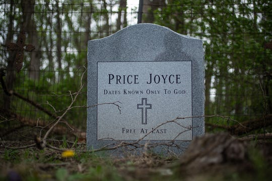 "The grave of Price Joyce sits in a small, multi-family cemetery plot, Rubush-Joyce or Sampson Cemetery, in southern Marion county on Wednesday, May 1, 2019. The grave of Joyce, a slave brought from Patrick County, Virginia to Indiana by Alexander Joyce in the 1830s, was unmarked until Joyce's great-great-great-grandson, Jeff Purvis, placed a head stone. ""I would like to believe the old family stories that he freed Price before leaving Virginia,"" said Purvis. ""But I see no compelling evidence to support that."""