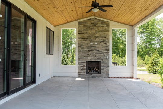 The covered back patio features a staggered-stone fireplace and hook-up for a television.