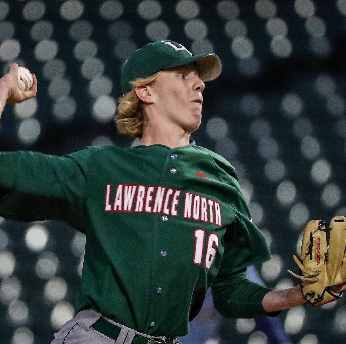 Lawrence North's Ty Johnson (16) pitches during Marion County tournament championships at Victory Field in Indianapolis, Friday, May 10, 2019. Lawrence North won, 3-0.