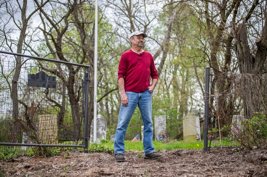 """Jeff Purvis stands in front of his family's gravesite in southern Marion county on Wednesday, May 1, 2019. The land where the gravesite sits was settled by Purvis' great-great-great-grandfather, Alexander Joyce, in the late 1830s. When he settled, Joyce brought a slave, Price Joyce, with him from Patrick County, Virginia. The grave of Price was unmarked until Purvis placed a stone where he believes Price's body lays. """"I didn't enslave this man,"""" said Purvis, wiping away tears. """"But I do have it in my power to apologize. And my God, I'm sorry. Too little, too late."""""""