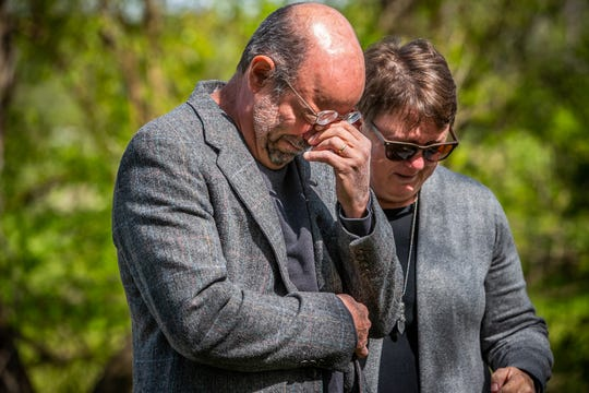 Jeff Purvis cries during a ceremony for Price Joyce, a slave once owned by his great-great-great-grandfather, Alexander Joyce II, on Saturday, May 11, 2019.