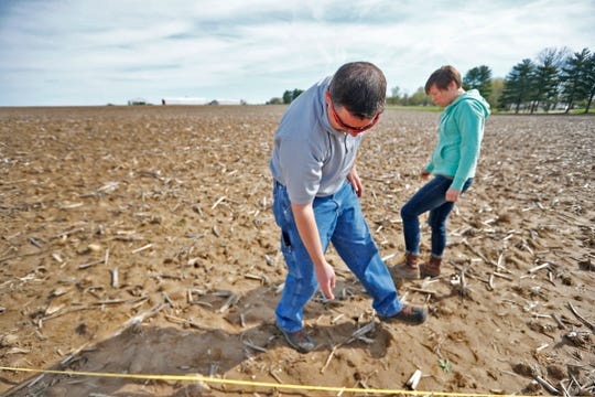 USDA conservationists, Indiana Natural Resources Conservation Service district conservationist Jerod Chew, left, and NRCS state soil specialist Stephanie McLain do a residue estimation to estimate the amount of cover or residue on this field, Monday, April 22, 2019.