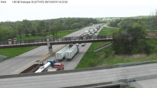 Traffic heading westbound on Interstate Highway 80near the Dubuque Street ramp in Iowa Cityslows to a crawl after road marking work closed down several lanes Monday, May 13, 2019.