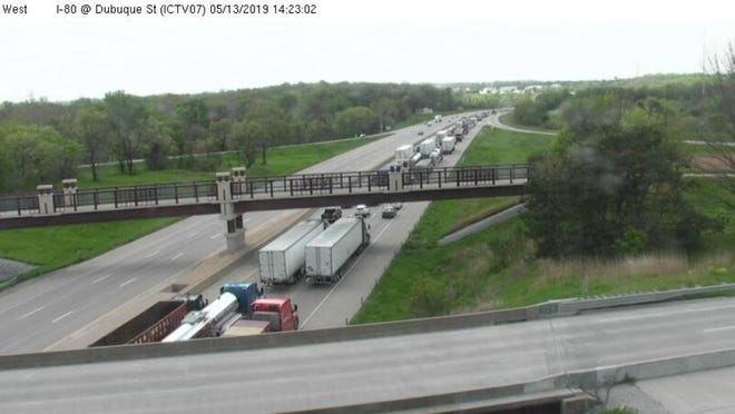 Traffic heading westbound on Interstate Highway 80 near the Dubuque Street ramp in Iowa City slows to a crawl after road marking work closed down several lanes Monday, May 13, 2019.