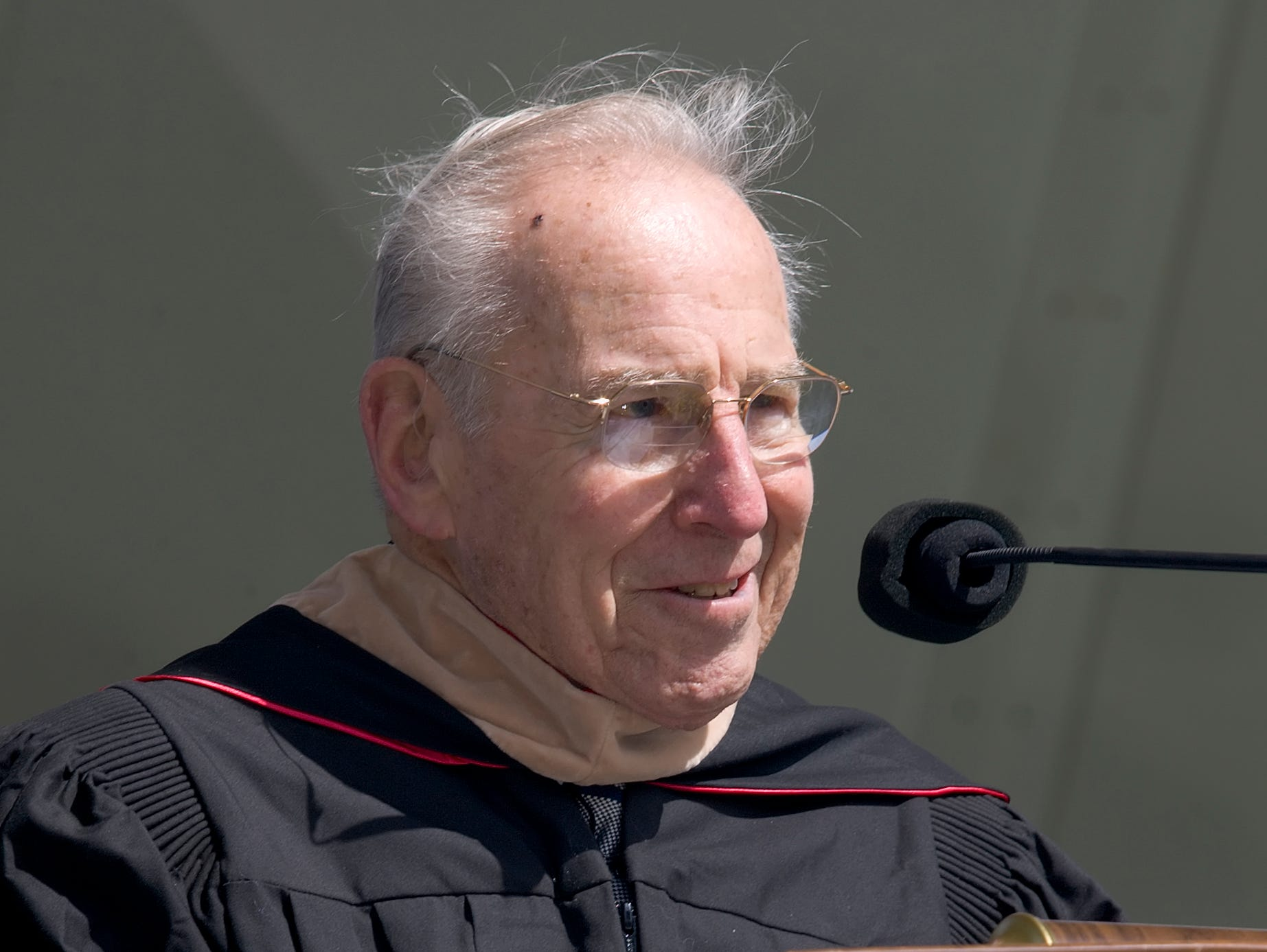 2009: Astronaut Jim Lovell speaks to the 2009 Ithaca College graduates about keeping an open mind Saturday at Butterfield Stadium.