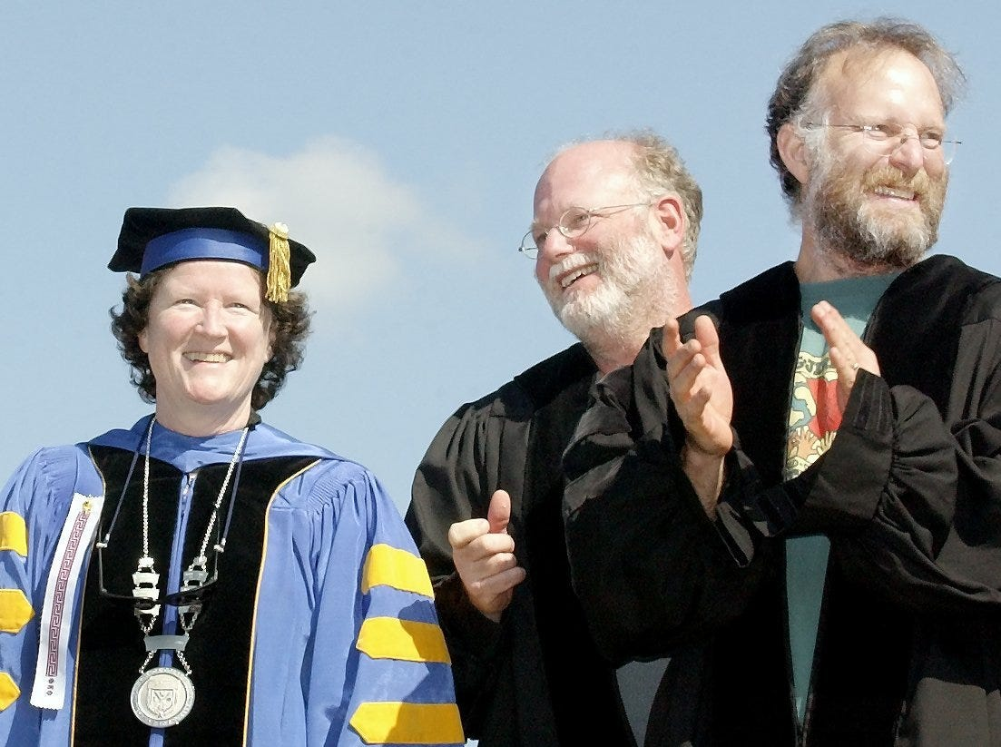 2003: Ithaca College President Peggy Williams joins Ben Cohen, center, and Jerry Greenfield in greeting Ithaca College graduates Sunday morning as they enter Butterfield Stadium.