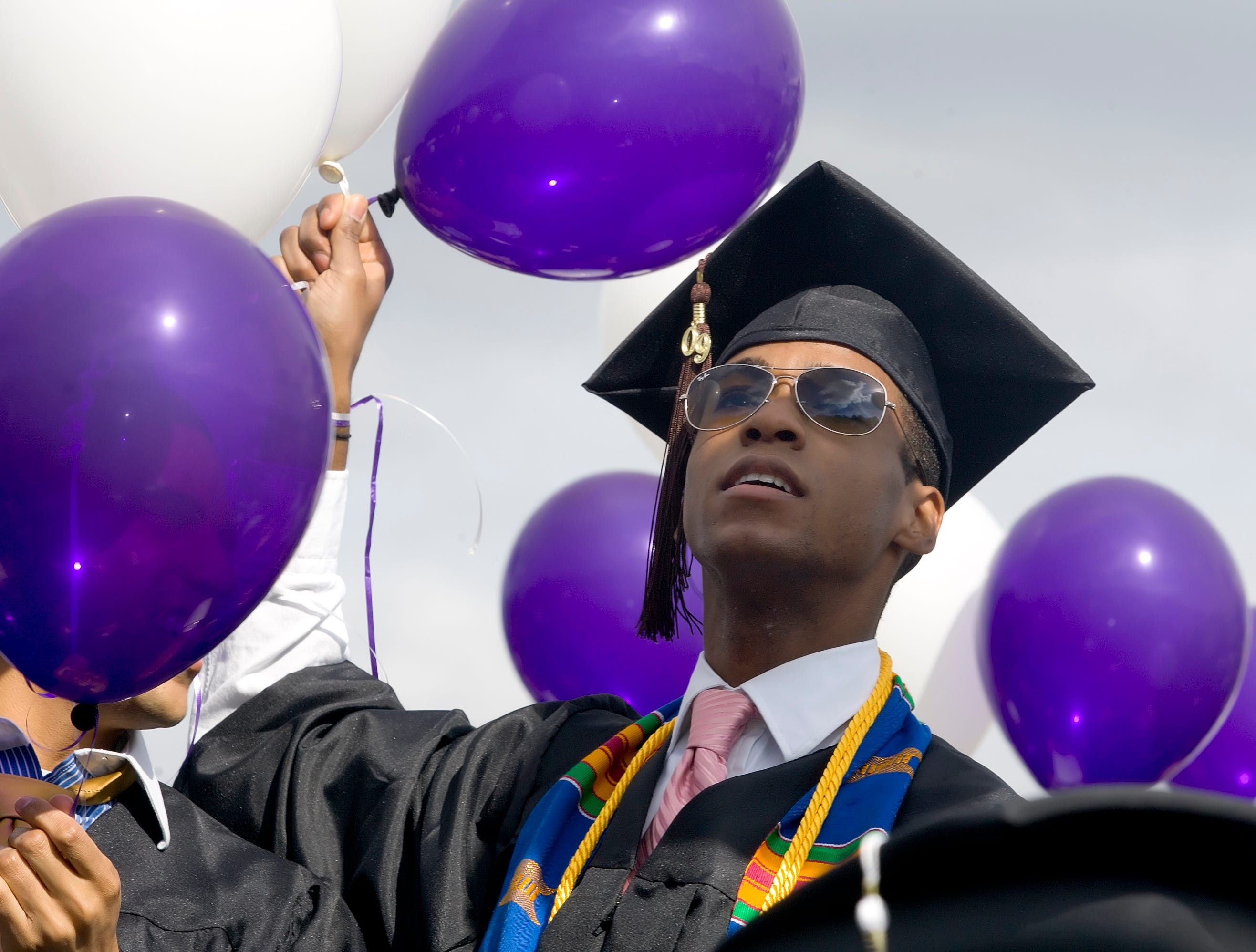 2009: Jeremy Reese looks at the crowd in the bleachers of Butterfield Stadium during the 2009 Ithaca College Commencement Ceremony.