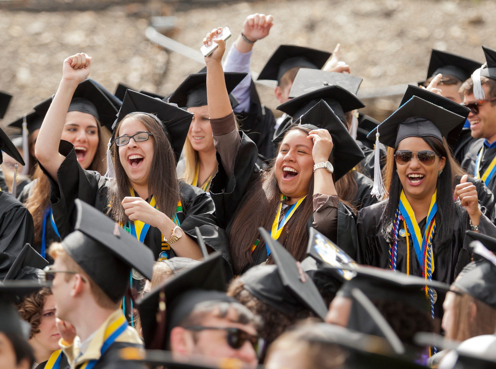 2014: Ithaca College graduates attend the 119th commencement ceremony Sunday morning in Butterfield Stadium.