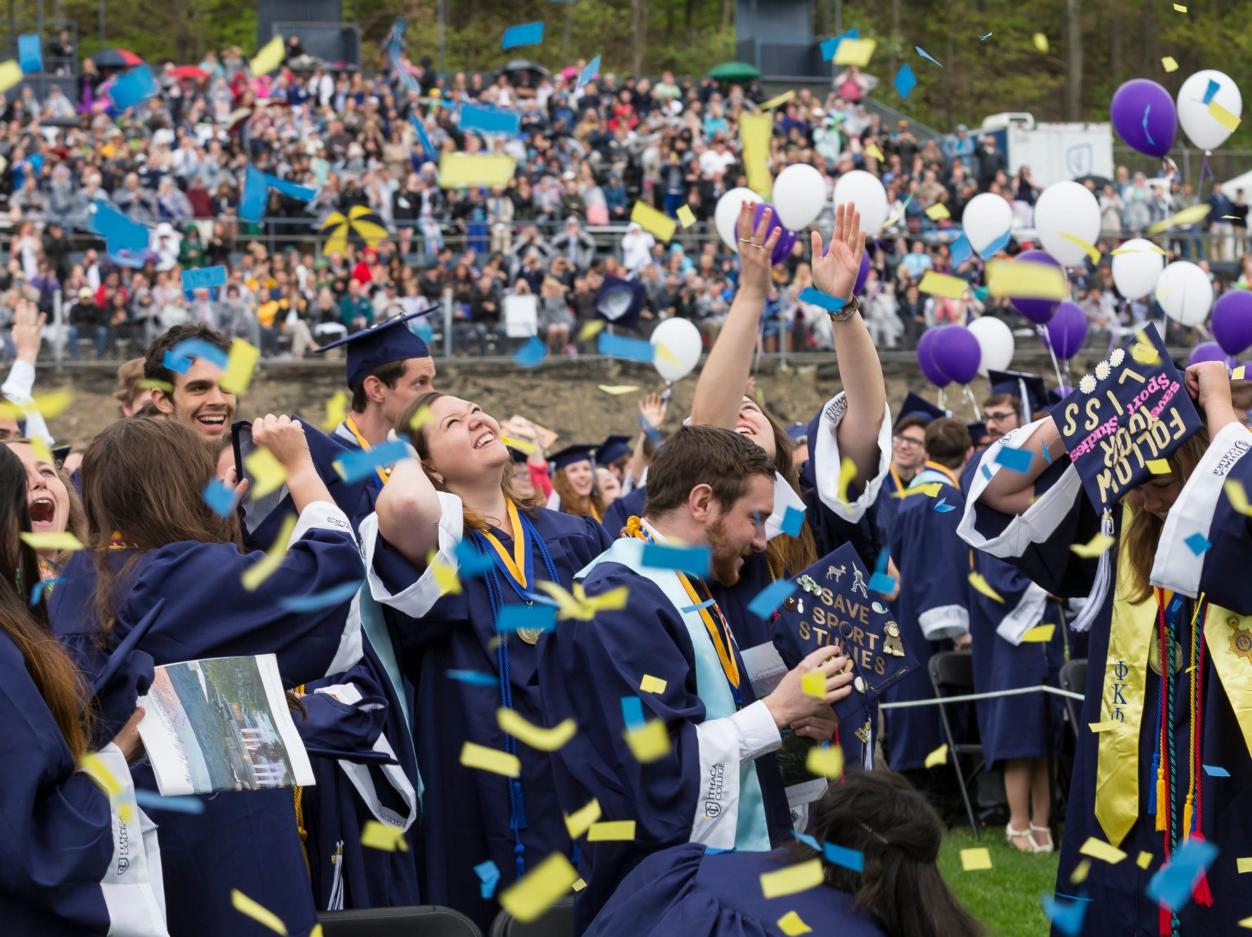 2016: Ithaca College graduates toss up their caps to celebrate.
