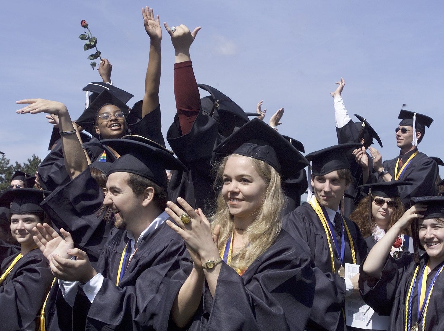2001: Ithaca College graduates celebrate at the end of commencement ceremonies Saturday at Butterfield Stadium. Under clear blue skies, 1,318 students became graduates in the school's 106th commencement.