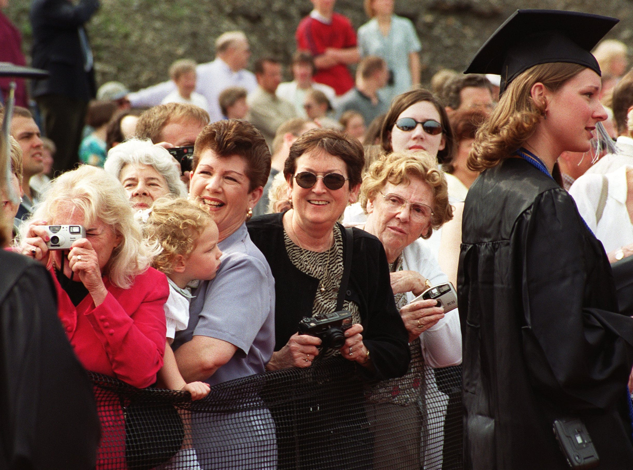 2000: Parents, friends and relatives watch as Ithaca College graduates walk into Butterfield Stadium Saturday for the school's 105th commencement. There were 1,325 students in the graduating class.