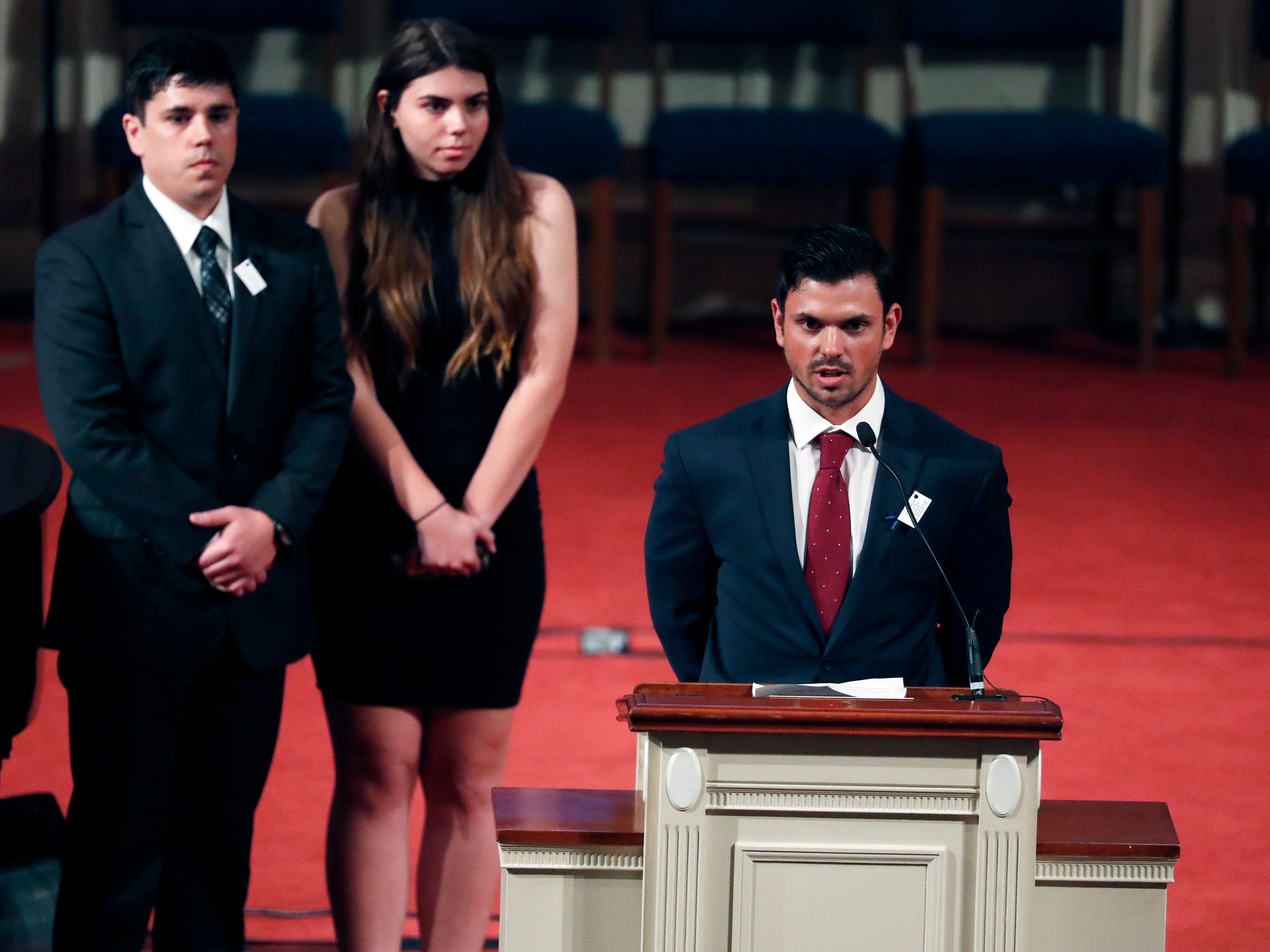 Logan Grundel, step-son of officer Robert S. McKeithen, speaks of his care for them and his love of duty, during McKeithen' funeral at the First Baptist Church of Biloxi, Monday, May 13, 2019. Brother Levi and sister Lauren Grundel also spoke to a filled church.
