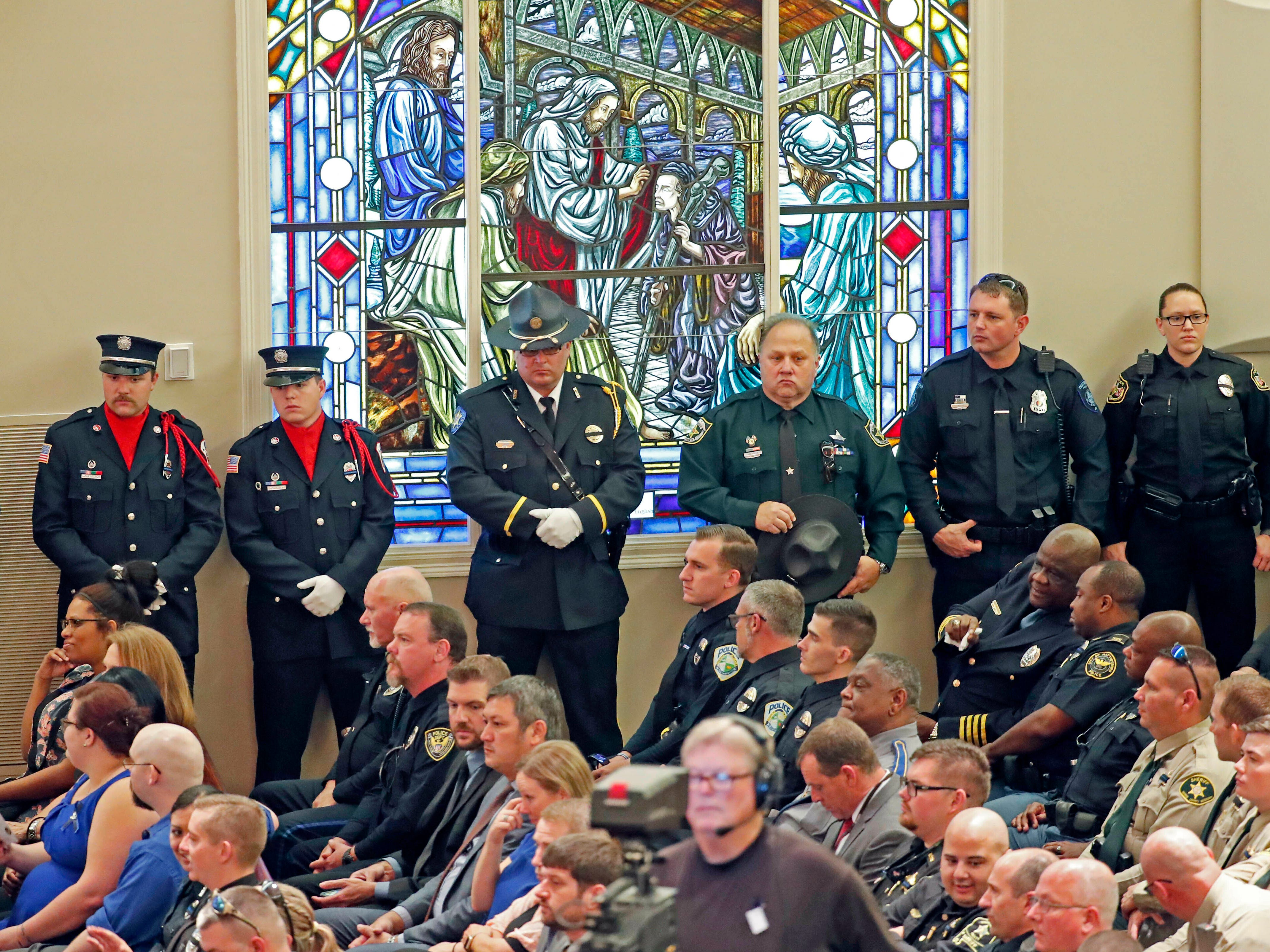 Visiting law enforcement officers, friends and community residents, filled the First Baptist Church of Biloxi, as they attended the funeral services of Biloxi, Miss., police officer Robert S. McKeithen, Monday, May 13, 2019, McKeithen was killed outside headquarters May 5.