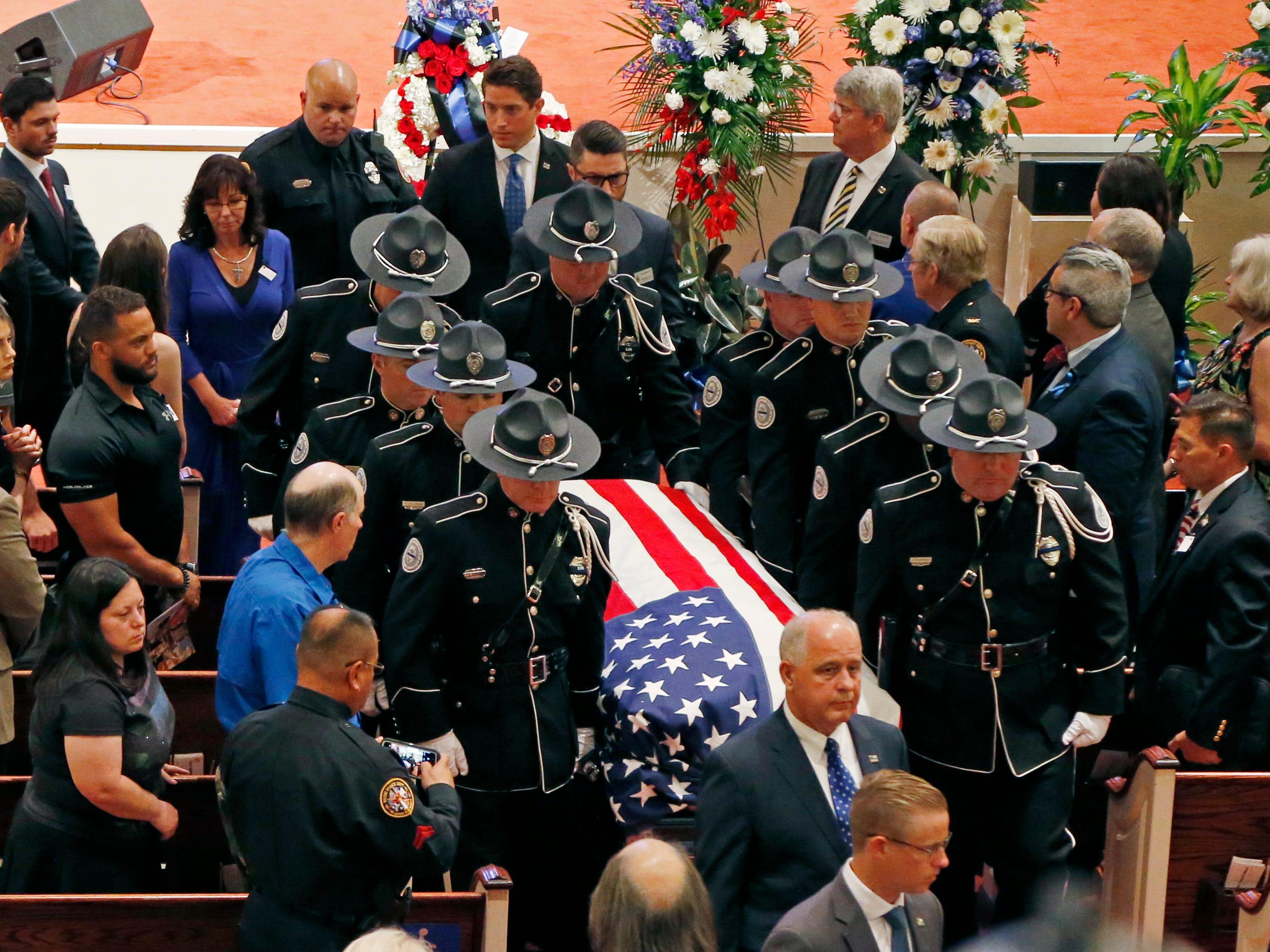 The City of Biloxi, Miss., Police Department Honor Guard, escort the casket of officer Robert S. McKeithen, out of First Baptist Church of Biloxi, Monday, May 13, 2019. Several hundred lawmen from around the country attended the service. McKeithen was killed outside headquarters May 5.