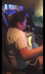 This video still shows a woman being arrested by Philadelphia, Miss., police officers.