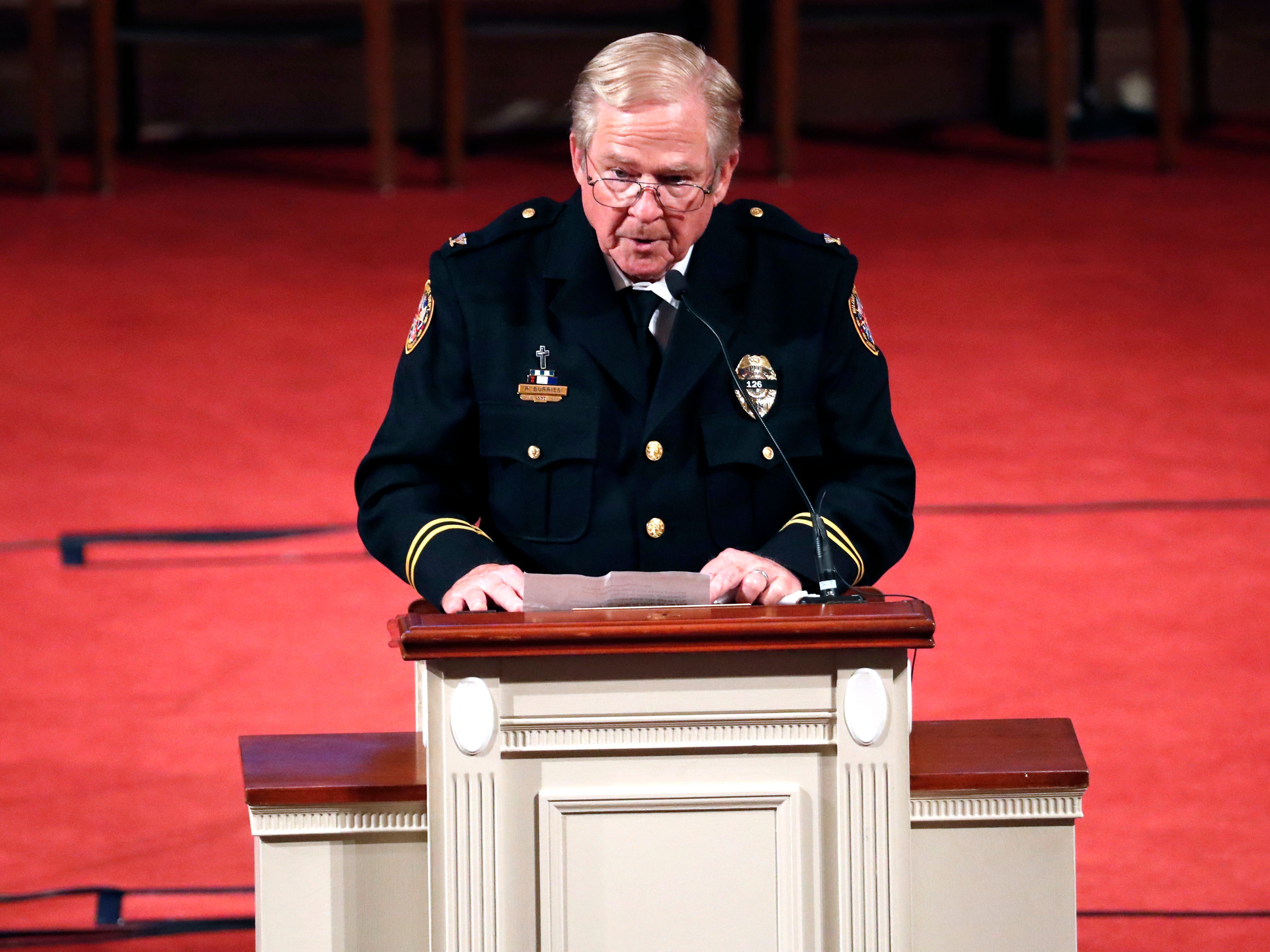 Biloxi, Miss., Police Department Chaplain Robert Burris, delivers a closing prayer for the late Biloxi police officer Robert S. McKeithen and his family at his funeral in the First Baptist Church of Biloxi, Monday, May 13, 2019.