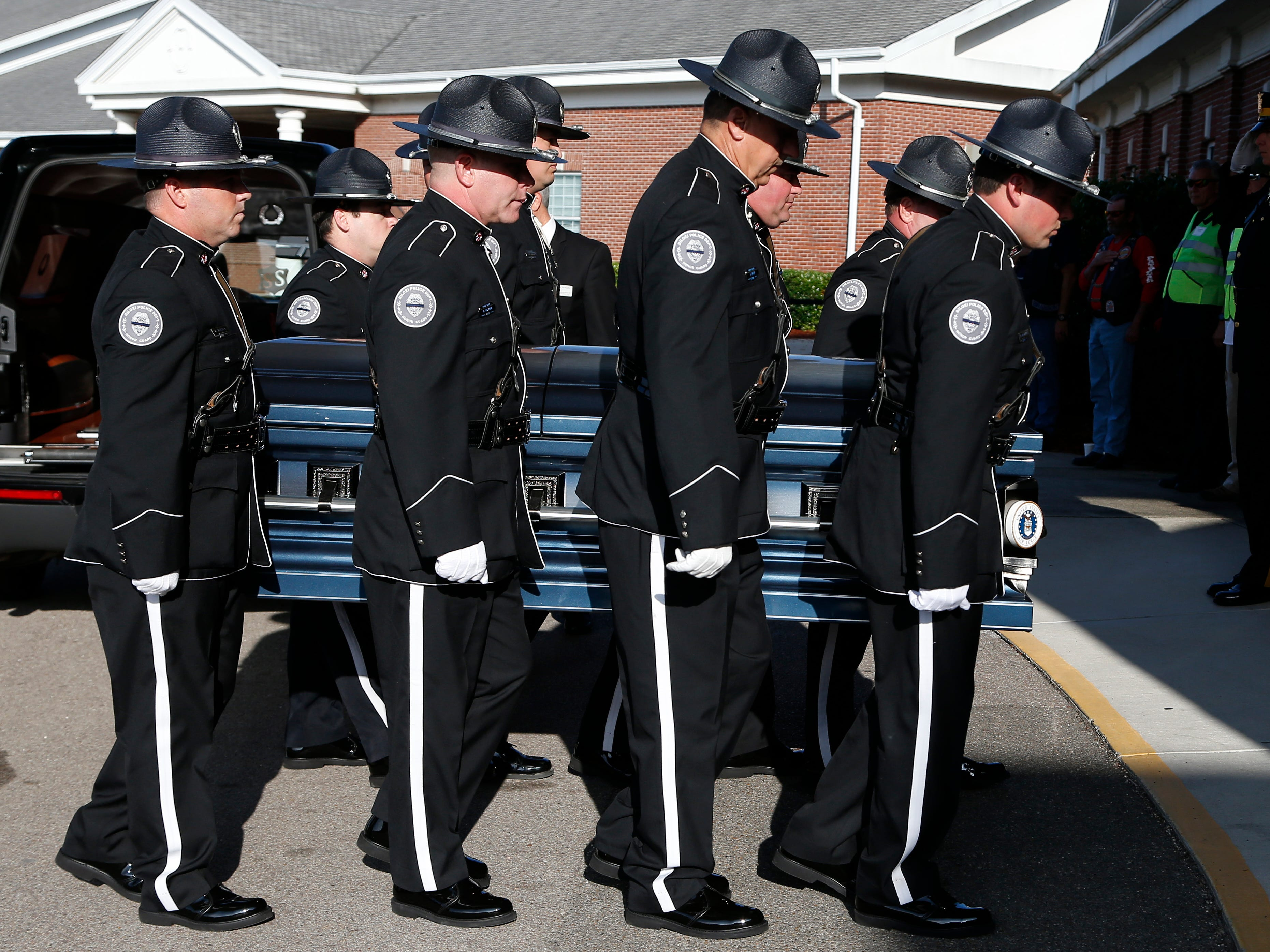 Members of the Biloxi Police Department Honor Guard escort the body of officer Robert McKeithen, into the First Baptist Church of Biloxi, Miss., Monday, May 13, 2019, for visitation. McKeithen was killed outside Biloxi's police station May 5.
