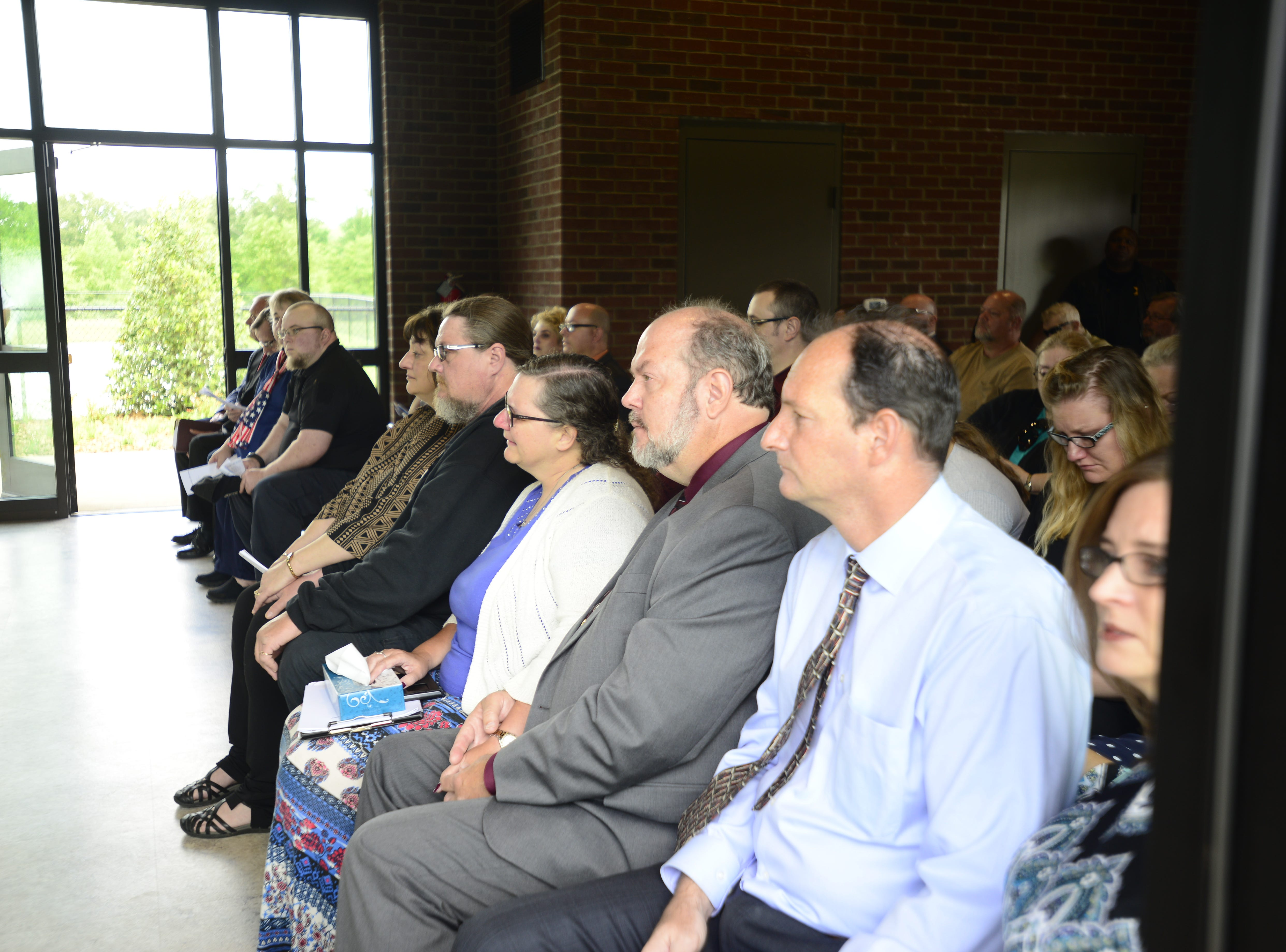 Robert Martin's family fill the front row during his funeral service.