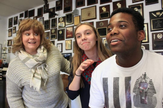 Suzanne Terry works with students Shannon Clarke and Isaiah McDermott in 2015.