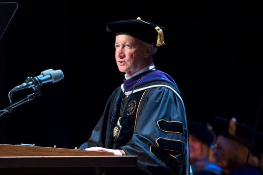 Purdue President Mitch Daniels addresses the university's newest graduates during commencement cermonies Saturday, May 11, 2019. Daniels talked about the grit that Boilermakers share.