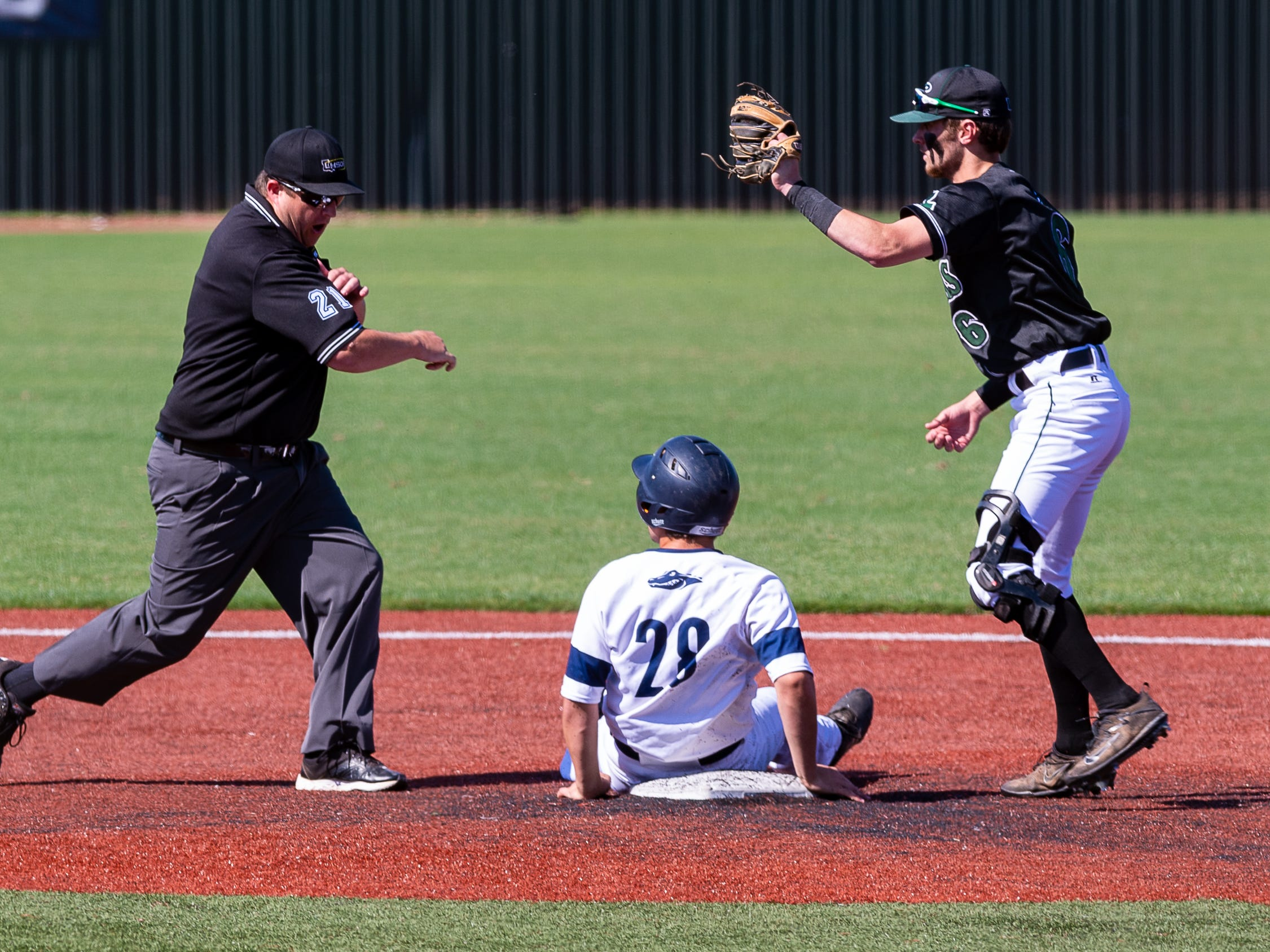 Second base umpire calls Carter Dooley out as Ascension Episcopal falls to Calvary Baptist Championship round at the LHSAA State Tournament. Monday, May 13, 2019.