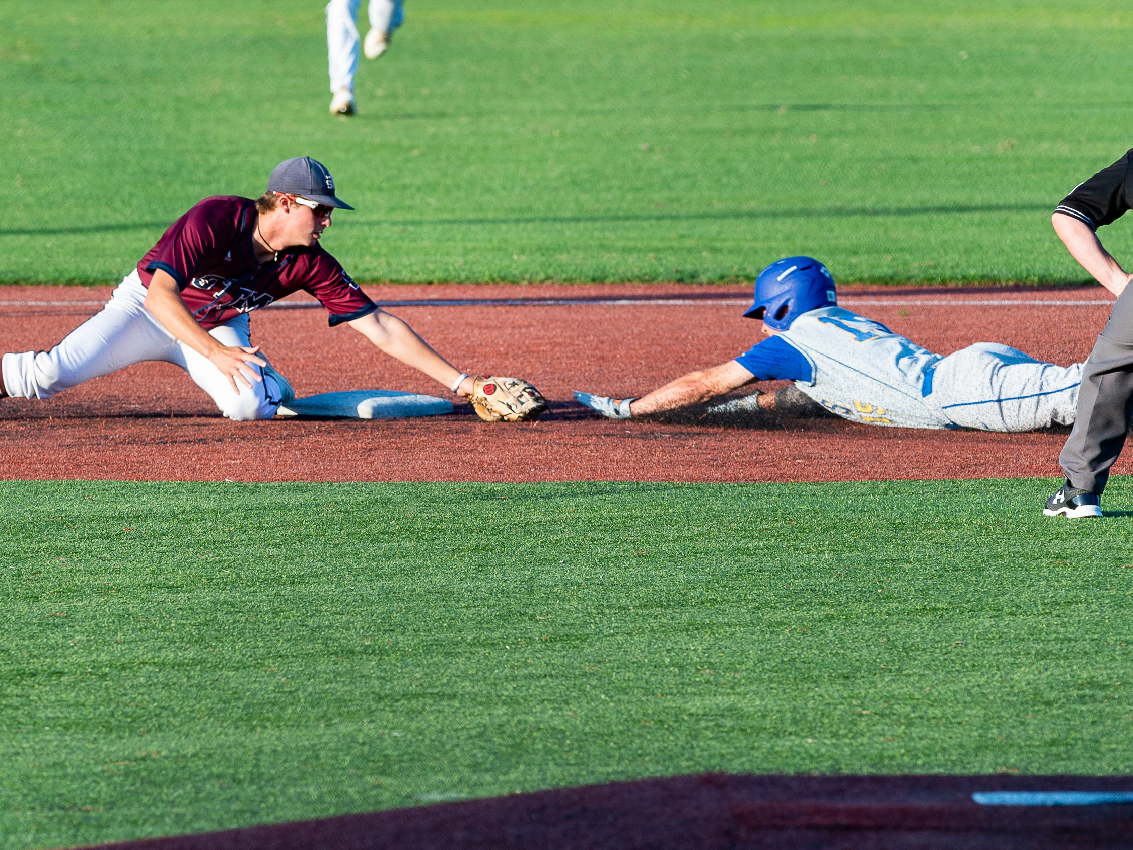 Connor Duffy makes the tag to get the out to end the inning as St Thomas More takes on St Charles  in the Div II semi final round at the LHSAA State Championship. . Sunday, May 12, 2019.