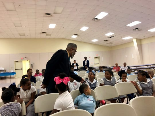 Fifteenth Judicial District Judge Jules Edwards III asks students questions during a special event Thursday, May 9 at Gethsemane Christian Academy in Lafayette.