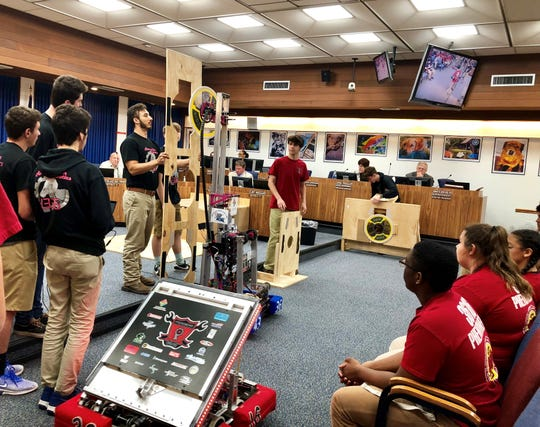 Lafayette Parish high school students showed off their award-winning robotics skills at a meeting of the Lafayette Parish School Board.