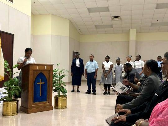 Angel Cahee, a seventh-grader at Gethsemane Christian Academy in Lafayette, talks about obedience during a special event at the school Thursday, May 9.