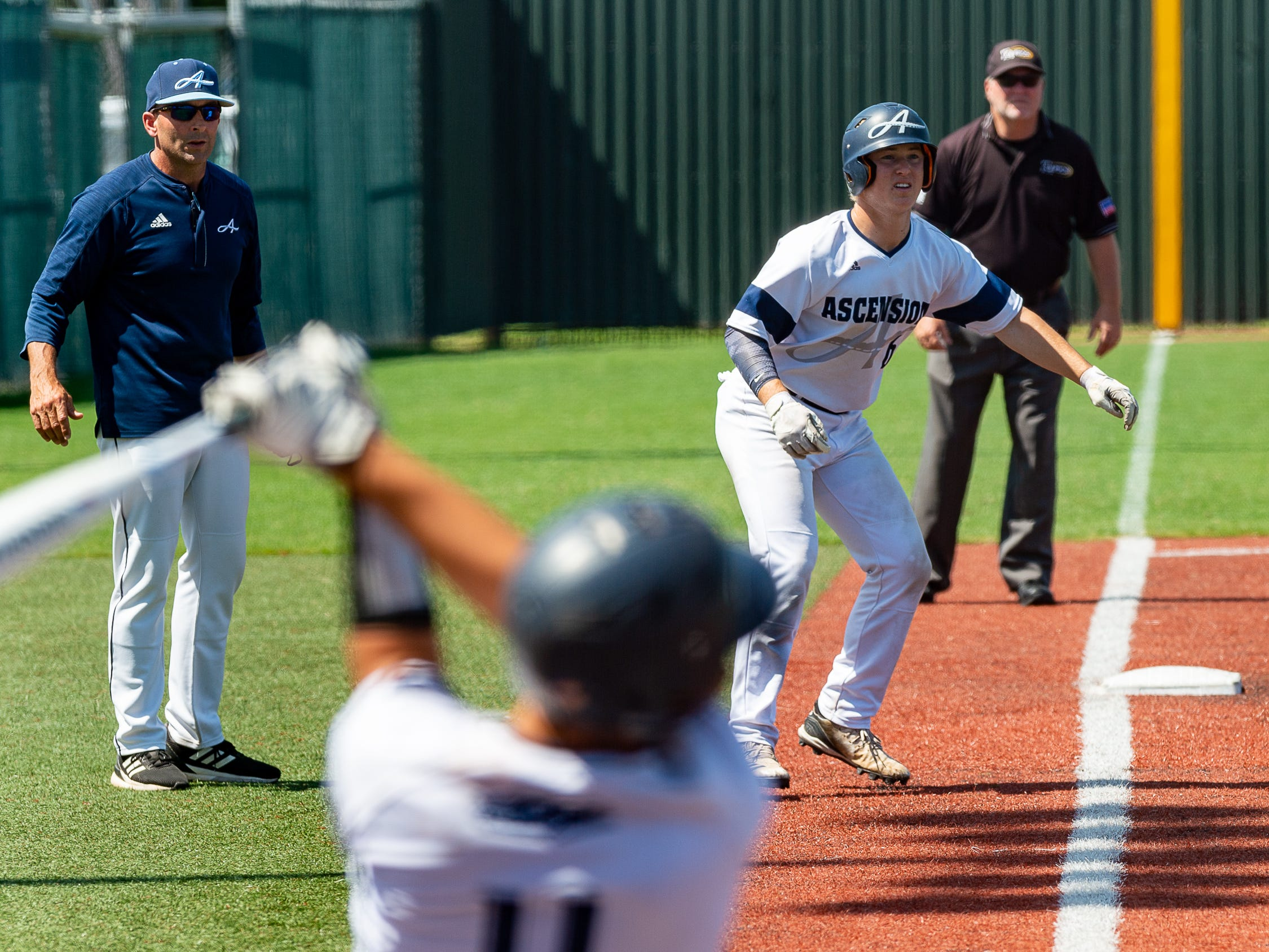 Seth Kerstetter takes a lead from third as Ascension Episcopal falls to Calvary Baptist Championship round at the LHSAA State Tournament. Monday, May 13, 2019.