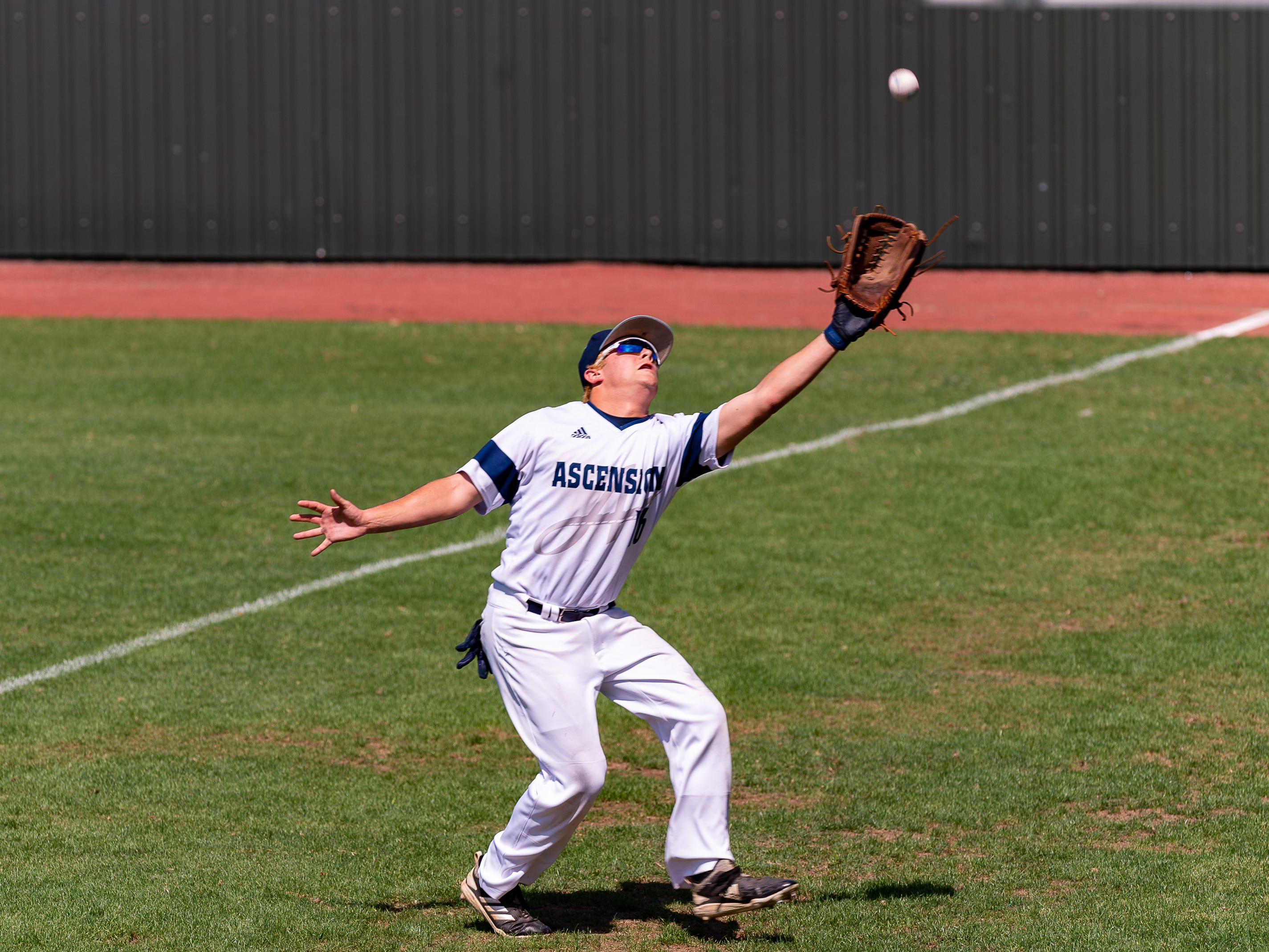 Blake Pearson chases down a foul ball for the out as Ascension Episcopal falls to Calvary Baptist Championship round at the LHSAA State Tournament. Monday, May 13, 2019.